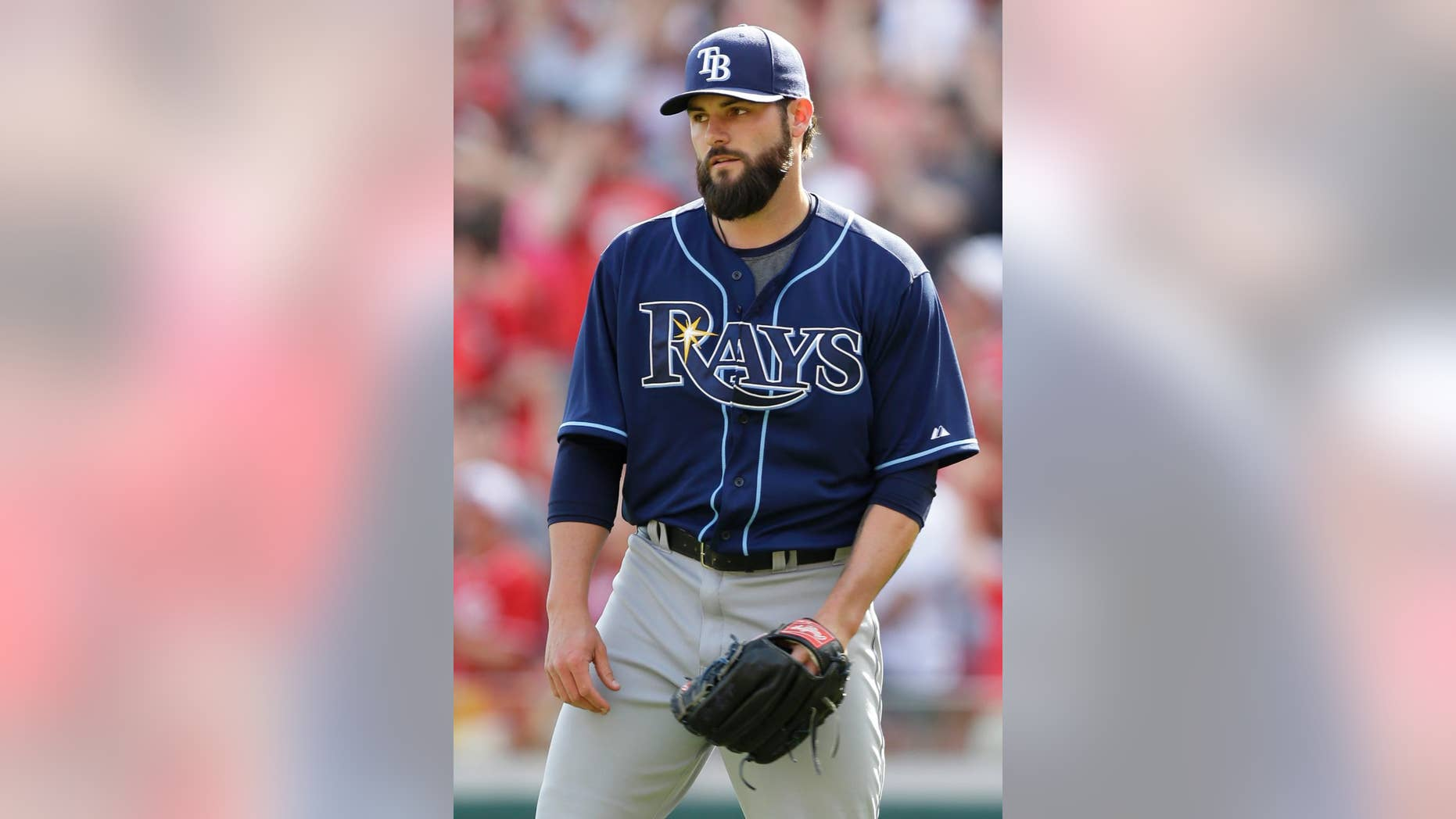 Tampa Bay Rays relief pitcher Josh Lueke turns toward the mound after giving up a pinch-hit grand slam to Cincinnati Reds' Chris Heisey in the eighth inning of a baseball game, Sunday, April 13, 2014, in Cincinnati. Cincinnati won 12-4. (AP Photo/Al Behrman)