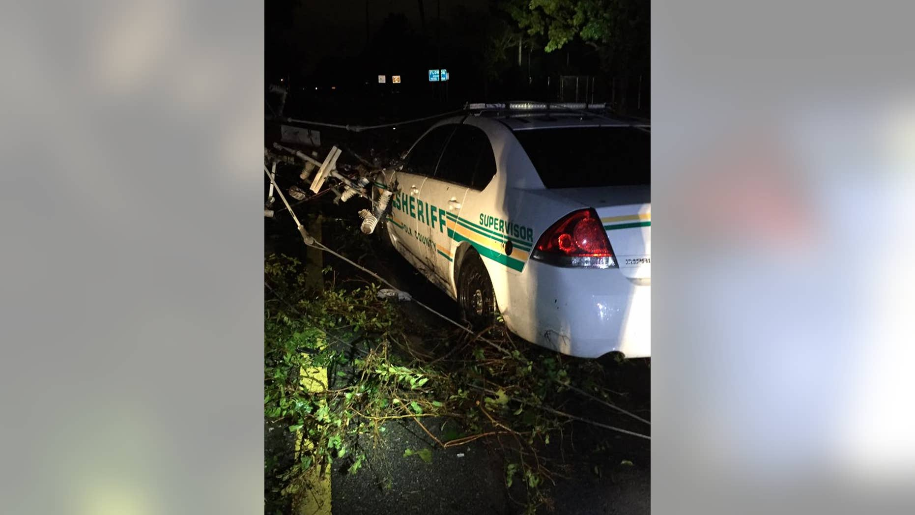 Two Florida first responders were rescued early Monday morning after being trapped in their car.