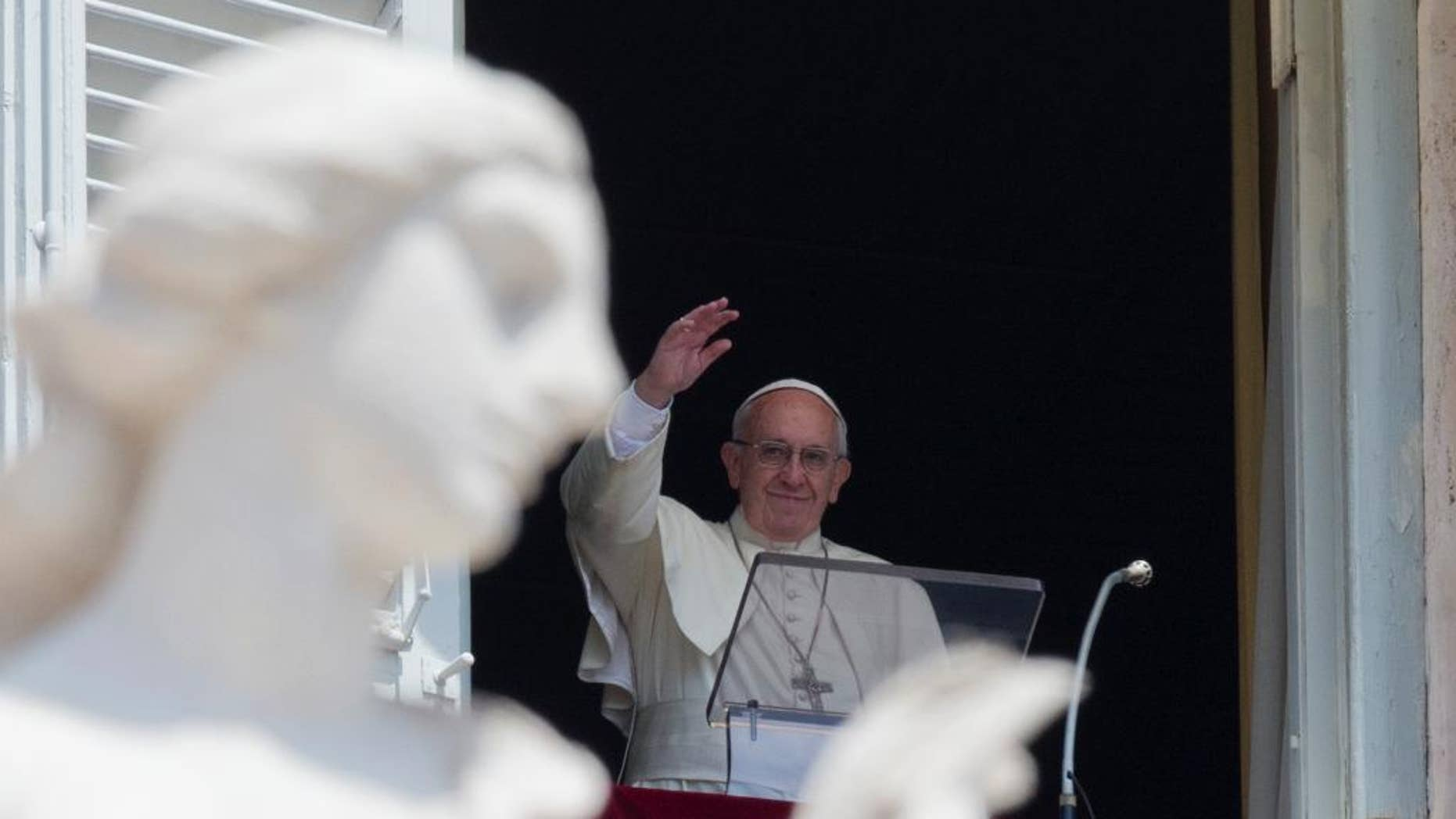 Pope Francis delivers his blessing during the Angelus noon prayer he celebrated from the window of his studio overlooking St. Peter's Square, at the Vatican, Sunday, July 10, 2016. (AP Photo/Andrew Medichini)