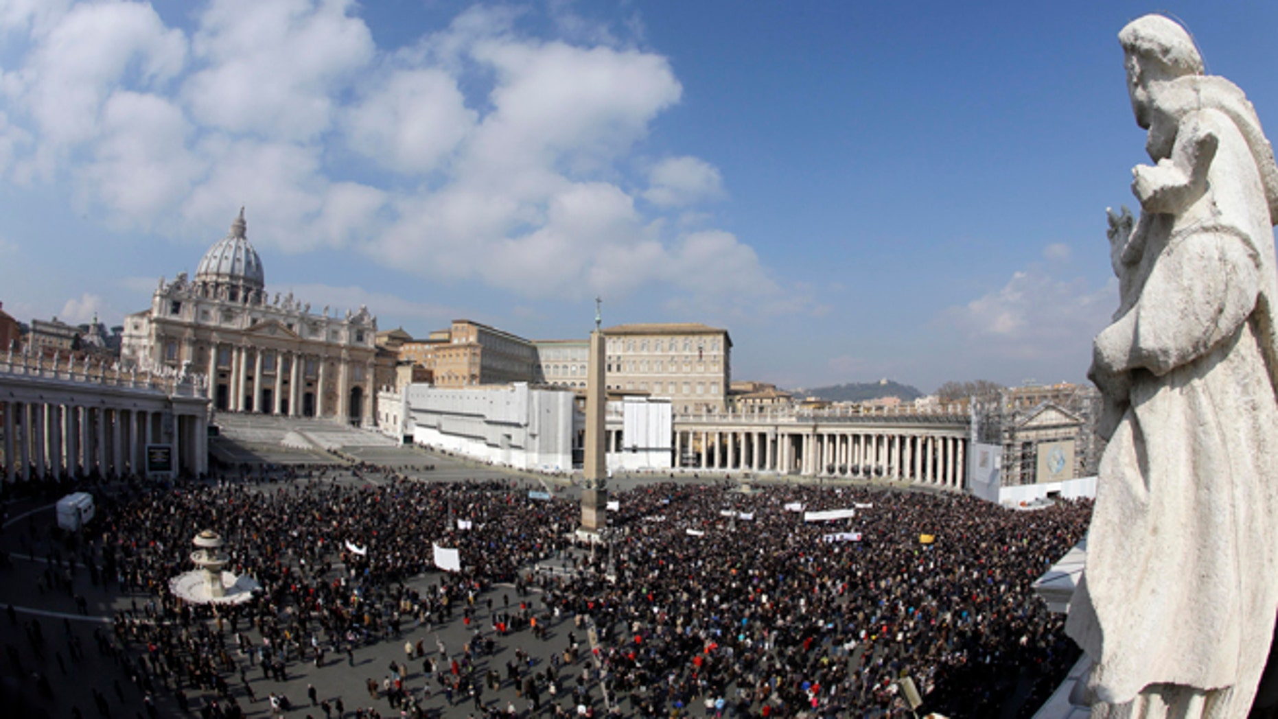 Faithful gather to listen to pope Benedict XVI's Angelus prayer in St. Peter's square at the Vatican, Sunday, Feb. 17, 2013. Pope Benedict XVI blessed the faithful from his window overlooking St. Peter's Square for the first time since announcing his resignation, cheered by an emotional crowd of tens of thousands of well-wishers from around the world. (AP Photo/Gregorio Borgia)
