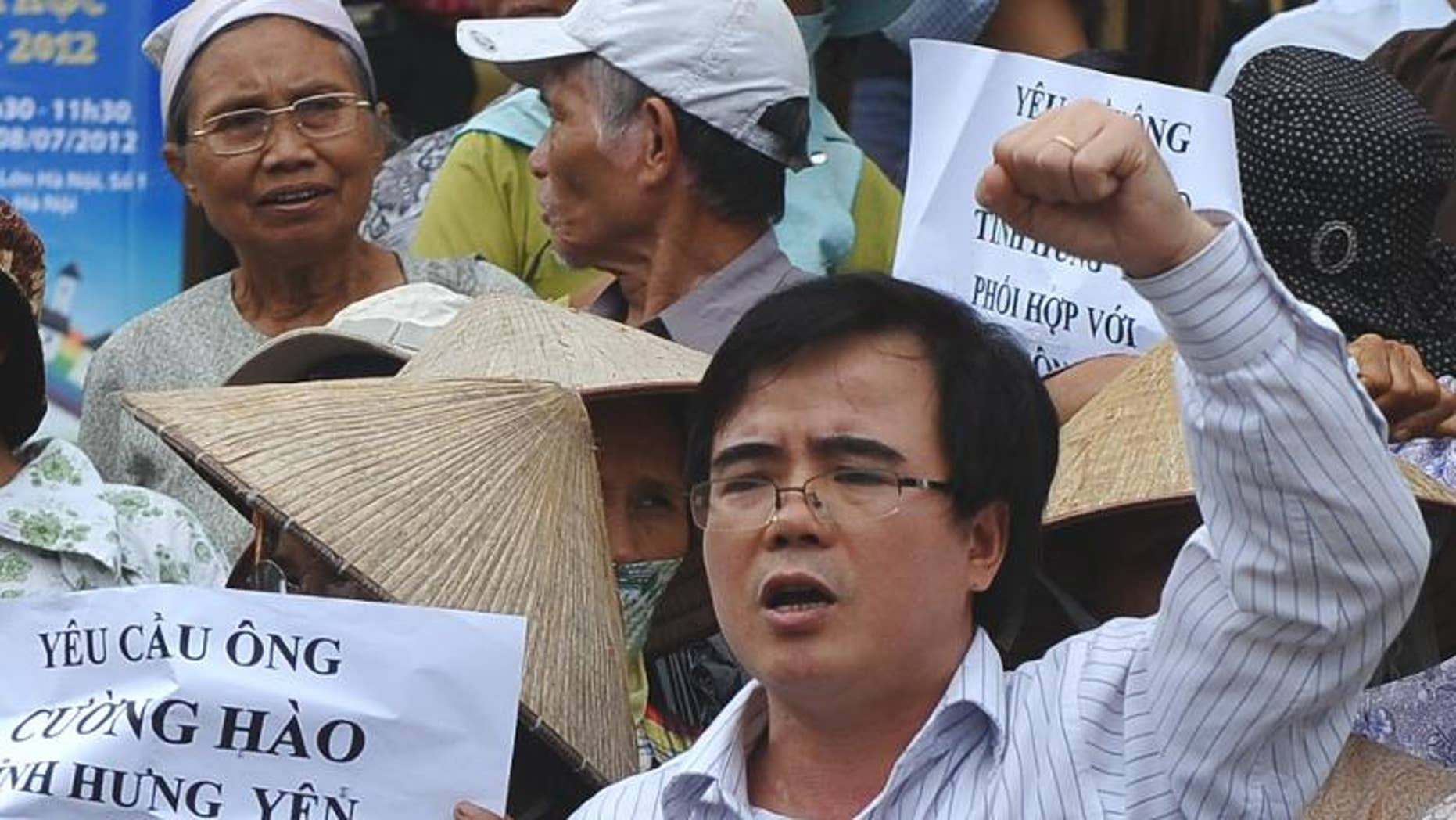 This picture taken on July 8, 2012 shows lawyer Le Quoc Quan (C) shouting during an anti-China rally in Hanoi