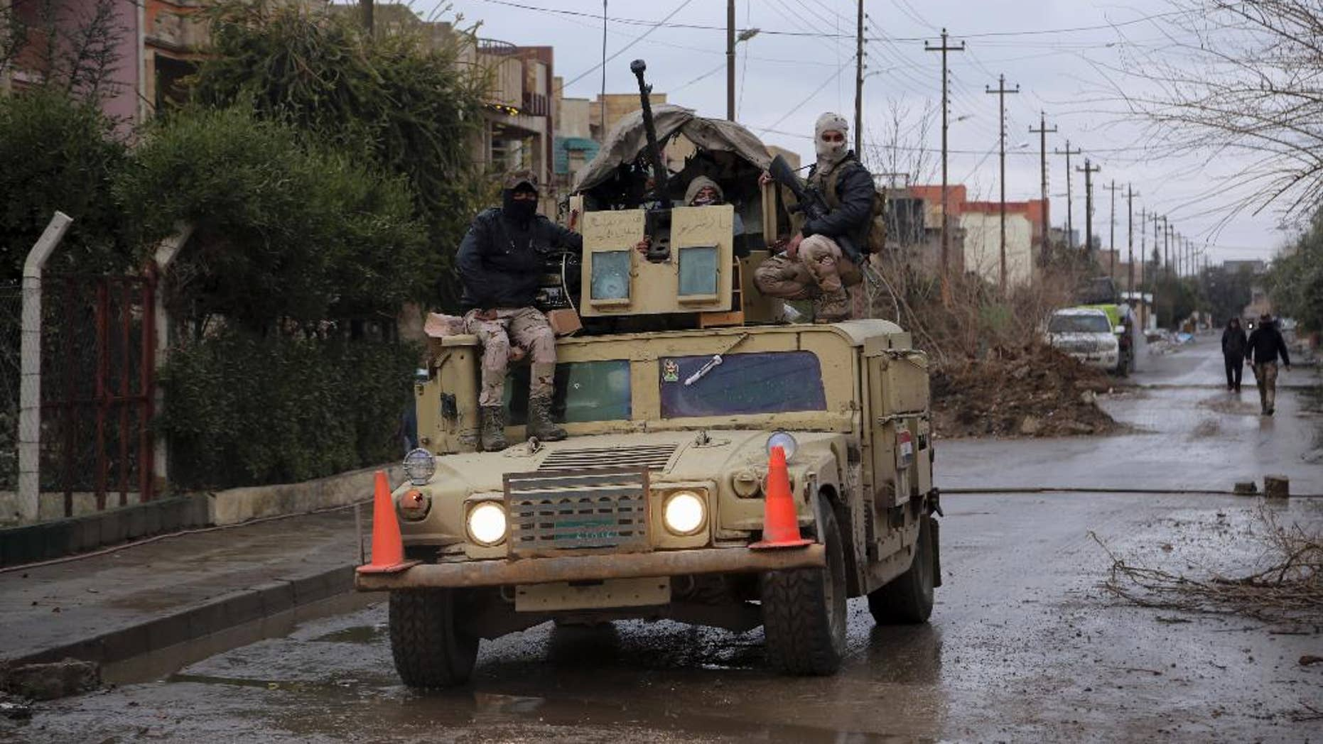 Iraq's Army forces patrol in the eastern side of Mosul, Iraq, Saturday, Jan. 28, 2017. (AP Photo/Khalid Mohammed)