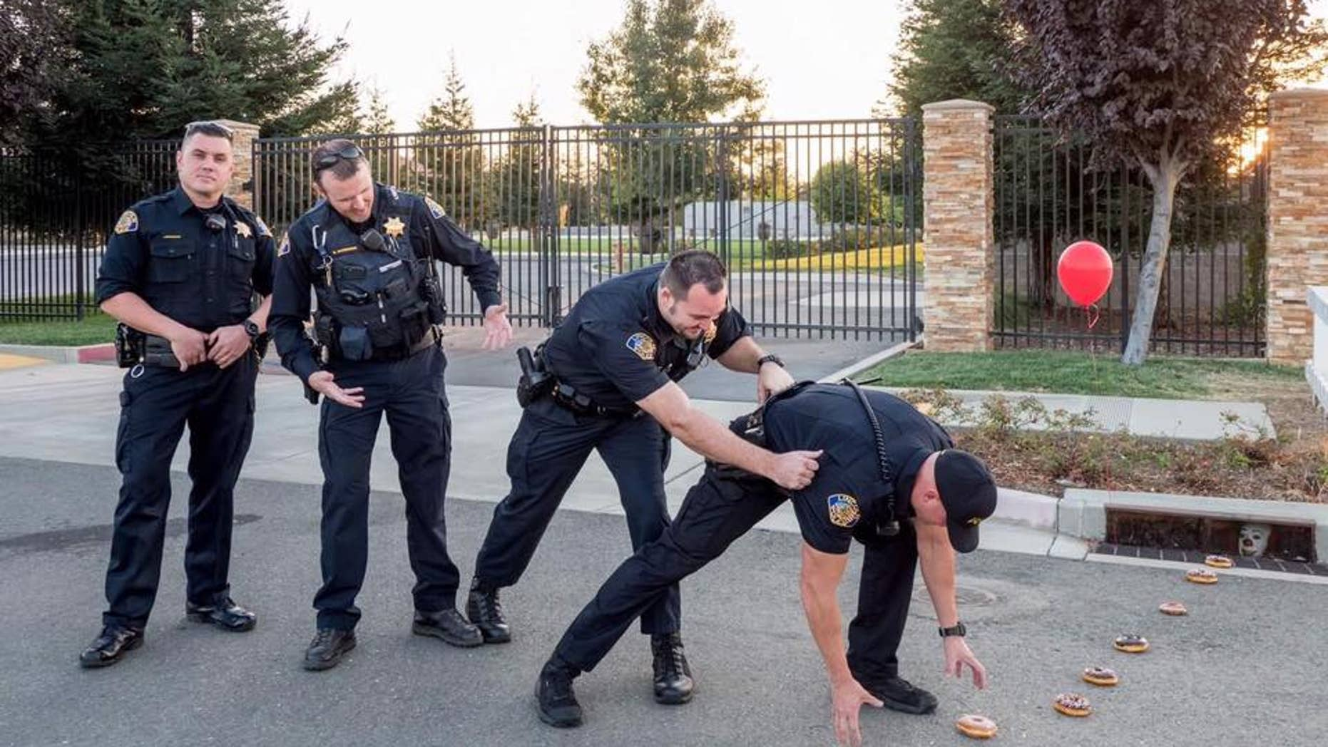 """The police officers posted a photo of their rendition of Stephen King's """"It."""""""
