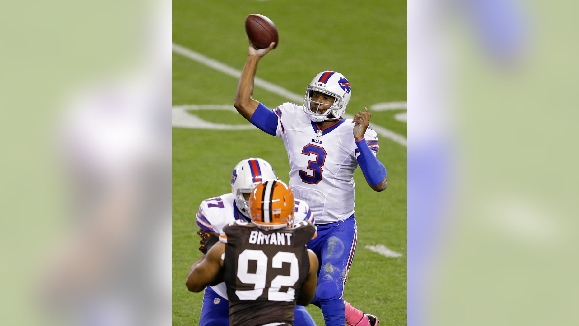 Buffalo Bills quarterback EJ Manuel (3) passes against the Cleveland Browns in the second quarter of an NFL football game Thursday, Oct. 3, 2013, in Cleveland. (AP Photo/Tony Dejak)