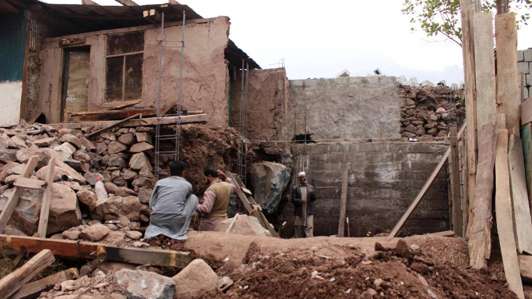 Pakistani villagers living at the Line of Control between Pakistan-Indian Kashmir, Chakoti, build concrete house in Pakistan, Monday, Nov. 21, 2016. Pakistan's military says Indian shelling has targeted several villages in Kashmir, killing scores of civilians and wounding others. (AP Photo/Roshan Mughal)