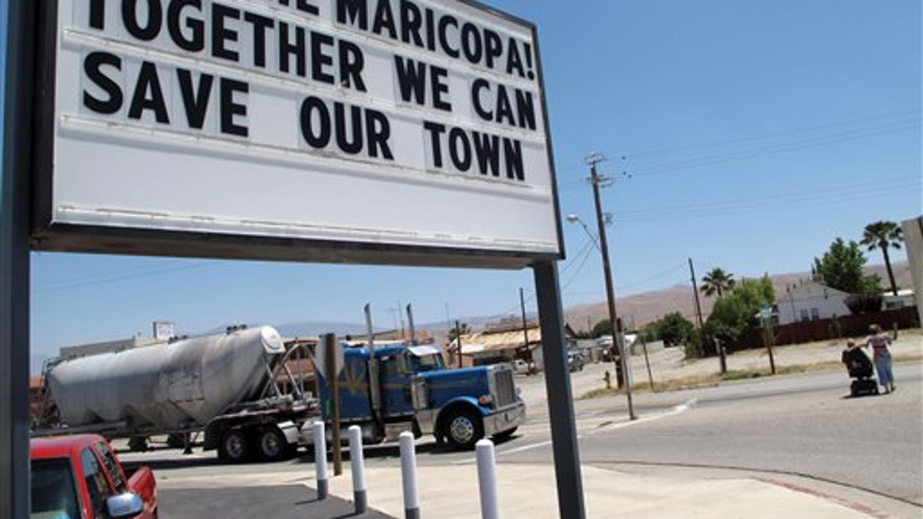 In this photo taken June 13, 2011, a sign is seen outside of the Shell gas station in Maricopa, Calif.  Its own county grand jury has recommended that this tiny San Joaquin Valley community be dissolved because It's too poor to be a town anymore. Though surrounded by oil derricks, the Kern Coiunty community is hopelessly in debt, can't pay its bills and has no source of revenue to contribute to a recovery. (AP Photo/Tracie Cone)