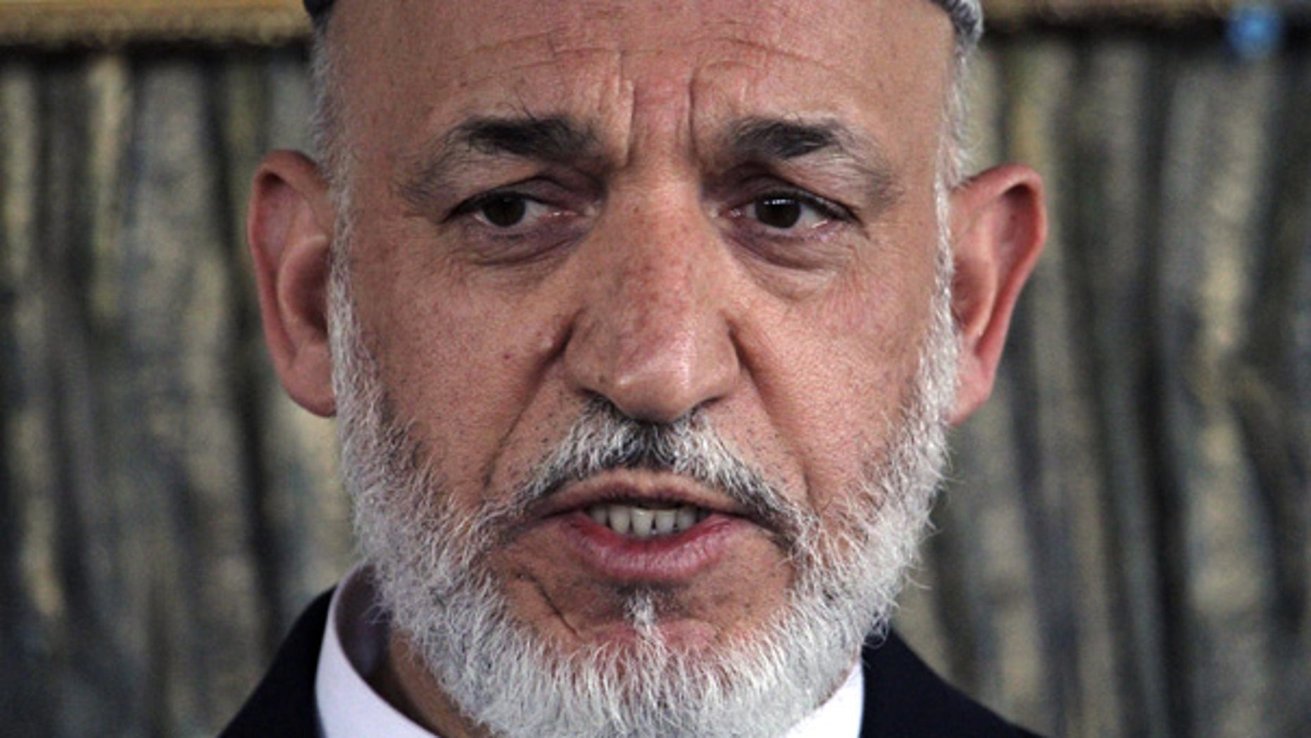 Oct. 9: Afghan President Hamid Karzai speaks in Kandahar province.