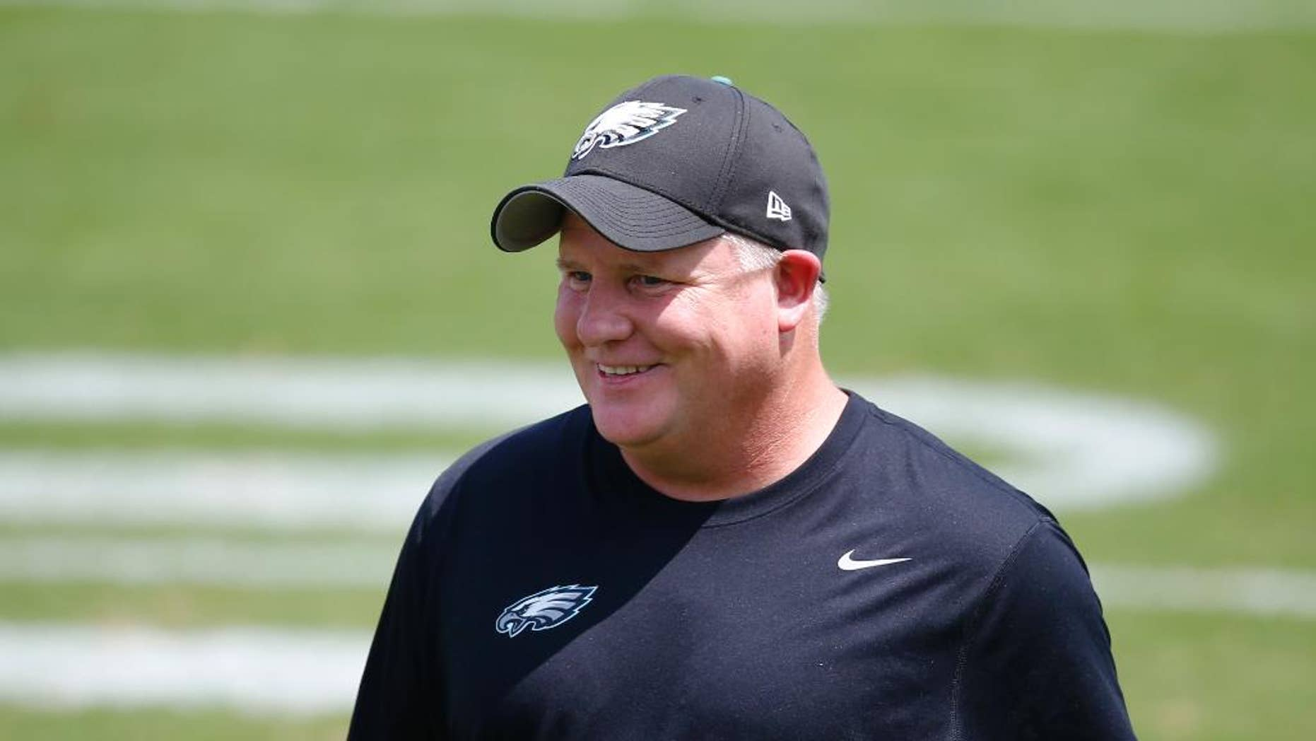 Philadelphia Eagles head coach Chip Kelly walks off the field during NFL football training camp Monday, Aug. 4, 2014, in Philadelphia. (AP Photo/Matt Rourke)