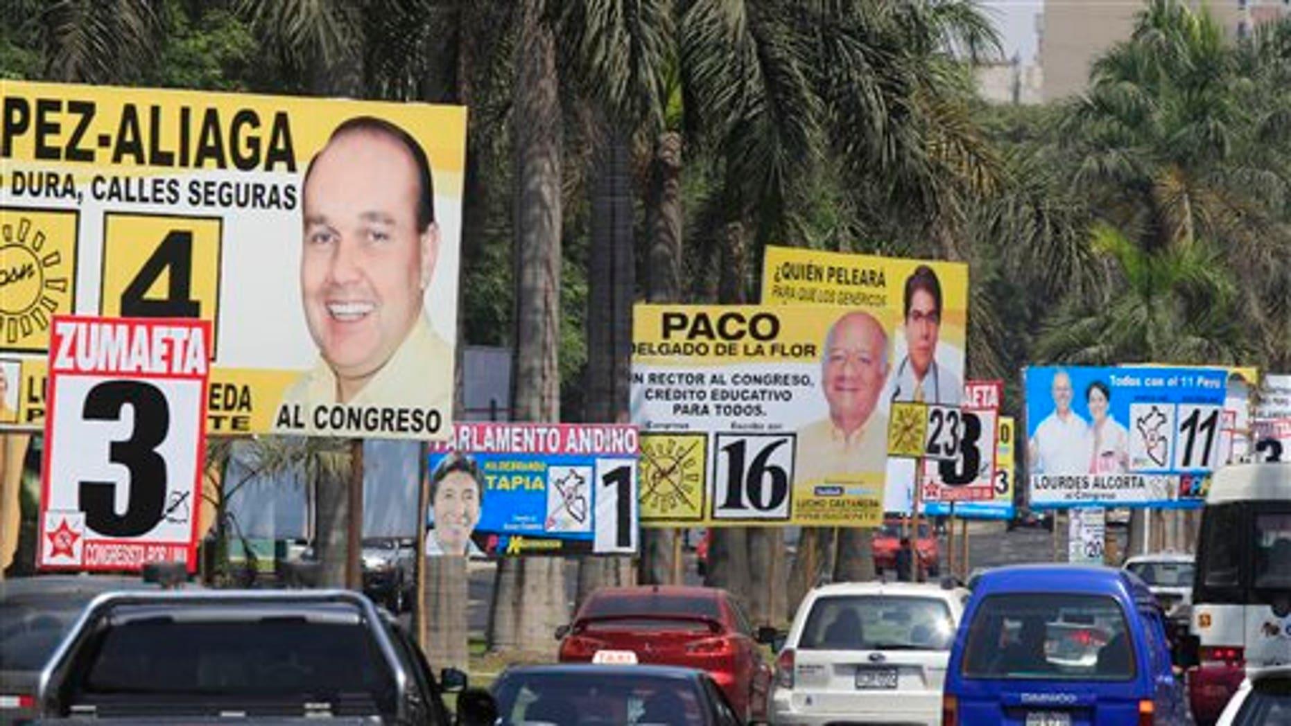 Cars drive past political campaign signs in Lima, Peru, Saturday April 9, 2011.  (AP Photo/Martin Mejia)