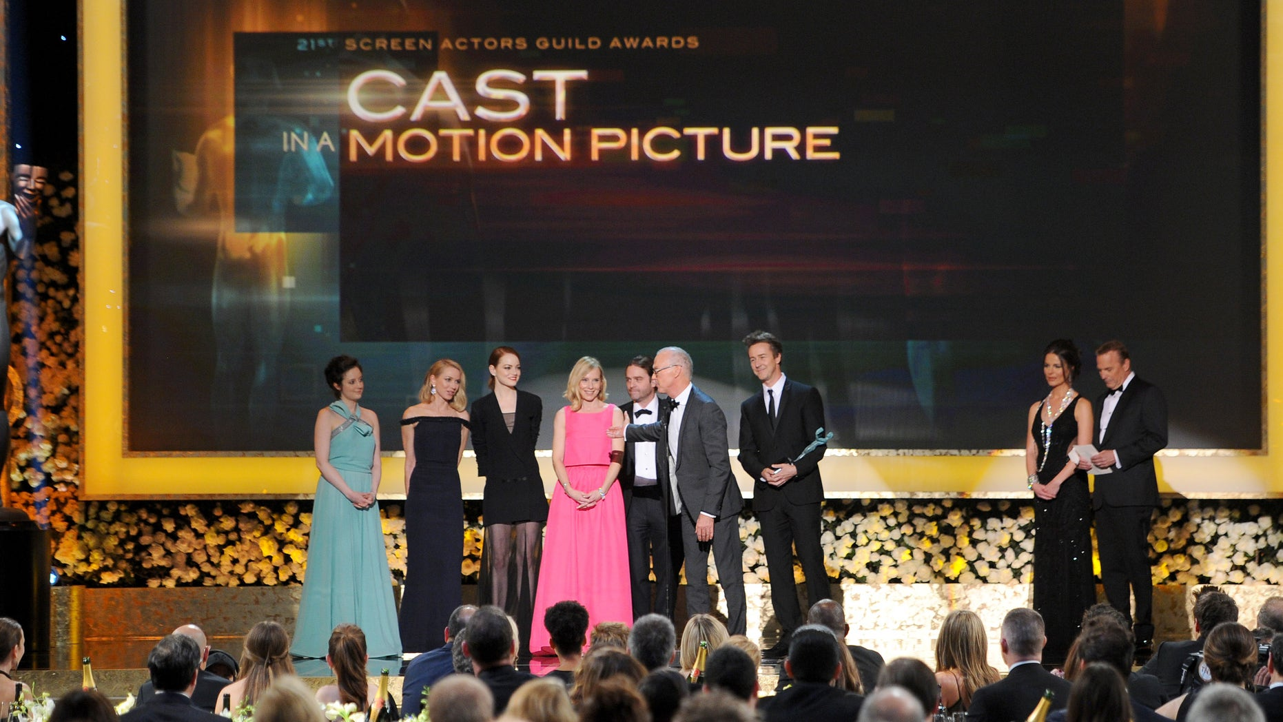 """The cast of """"Birdman"""" accepts the award for outstanding performance by a cast in a motion picture on stage during the 21st annual Screen Actors Guild Awards at the Shrine Auditorium on Sunday, Jan. 25, 2015, in Los Angeles. (Photo by Vince Bucci/Invision/AP)"""