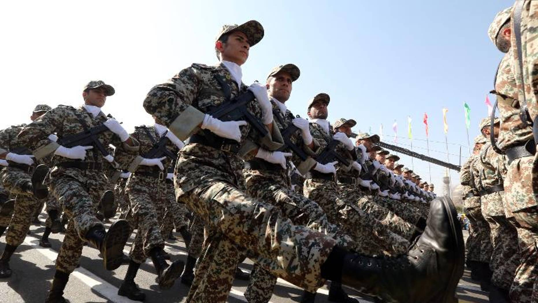 Iranian soldiers march past President Hassan Rowhani during an annual military parade in Tehran, on September 22, 2013