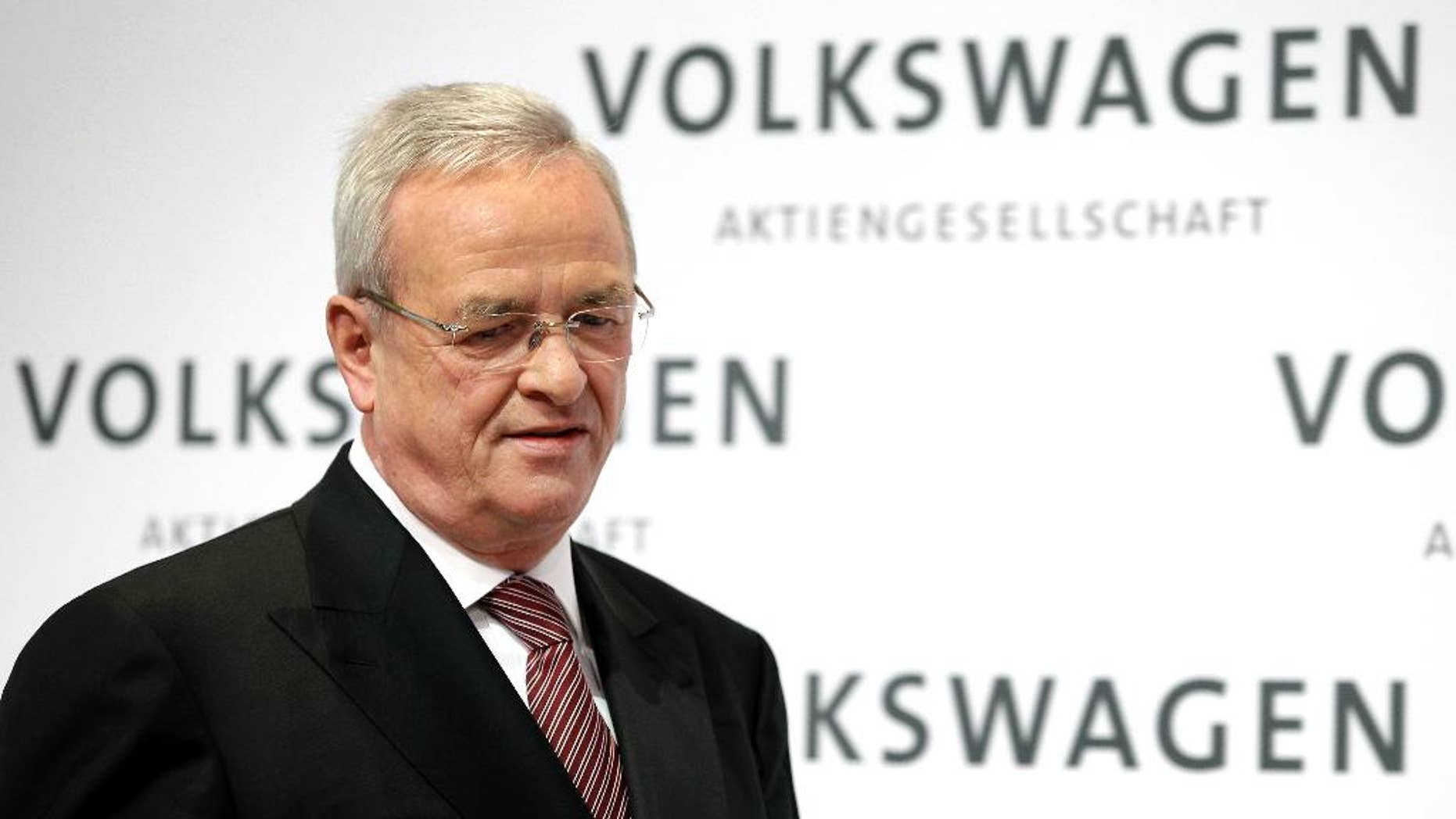 FILE - In this March 12, 2015 file picture then Volkswagen CEO Martin Winterkorn looks down as he arrives for the company's annual press conference in Berlin, Germany. Porsche Automobil Holding SE said Saturday, Oct. 17, 2015, that Winterkorn will depart as CEO and executive board member by the end of the month. (AP Photo/Michael Sohn, file)