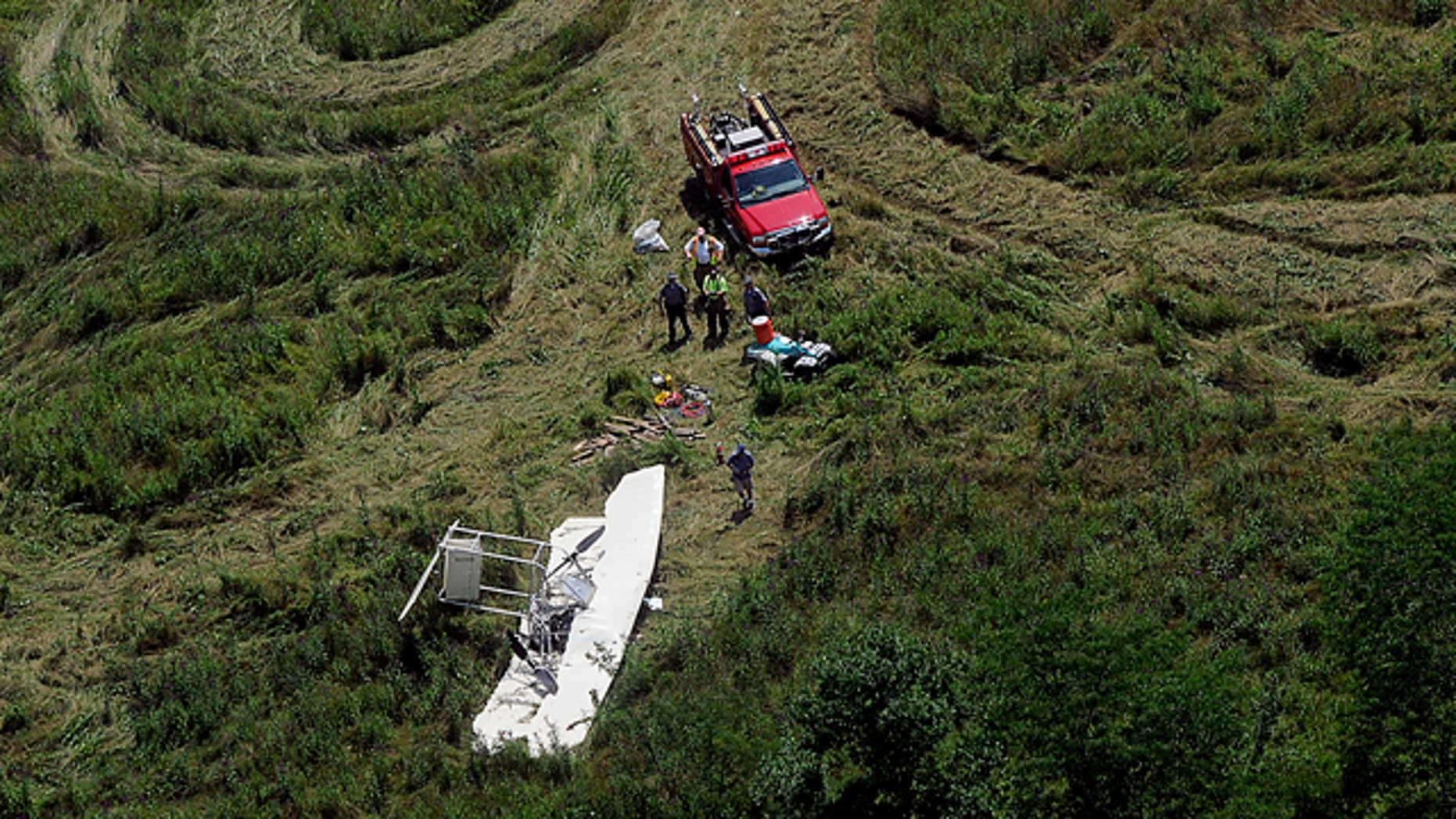 July 30: Officials inspect the scene of a small plane crash about near Springfield, Ohio.