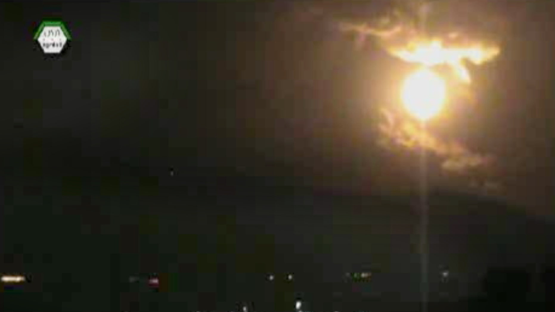 In this image taken from video obtained from the Ugarit News, which has been authenticated based on its contents and other AP reporting, a Israeli airstrikes hit Damascus, Syria, early Sunday, May 5, 2013. Israeli warplanes struck areas in and around the Syrian capital Sunday, setting off a series of explosions as they targeted a shipment of highly accurate, Iranian-made guided missiles believed to be on their way to Lebanon's Hezbollah militant group, officials and activists said. The attack, the second in three days, signaled a sharp escalation of Israel's involvement in Syria's bloody civil war. Syria's state media reported that Israeli missiles struck a military and scientific research center near the Syrian capital and caused casualties. (AP Photo/Ugarit News via AP video)
