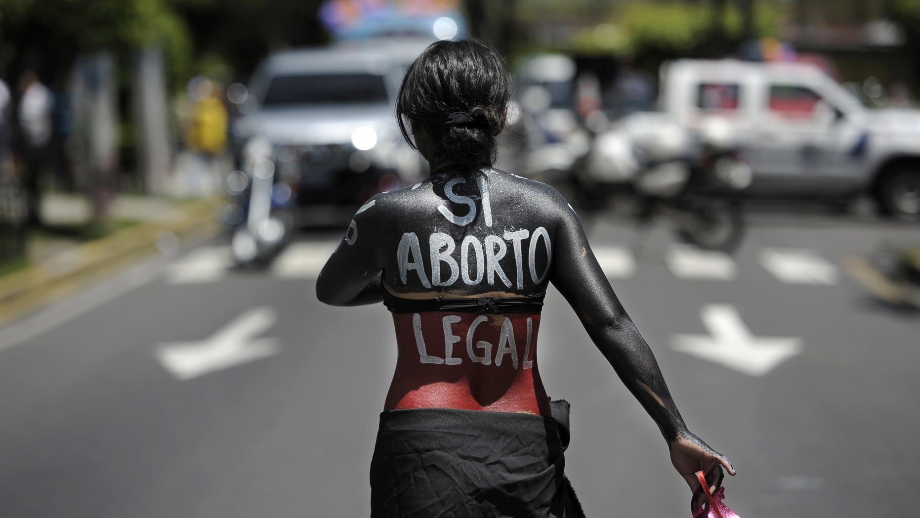 A woman participates in a march on the International Day of Action for the Decriminalization of Abortion, on September 28, 2012 in San Salvador. Salvadorean women marched to ask the government to legalize abortion as a right for women.  AFP PHOTO/Jose CABEZAS        (Photo credit should read Jose CABEZAS/AFP/GettyImages)