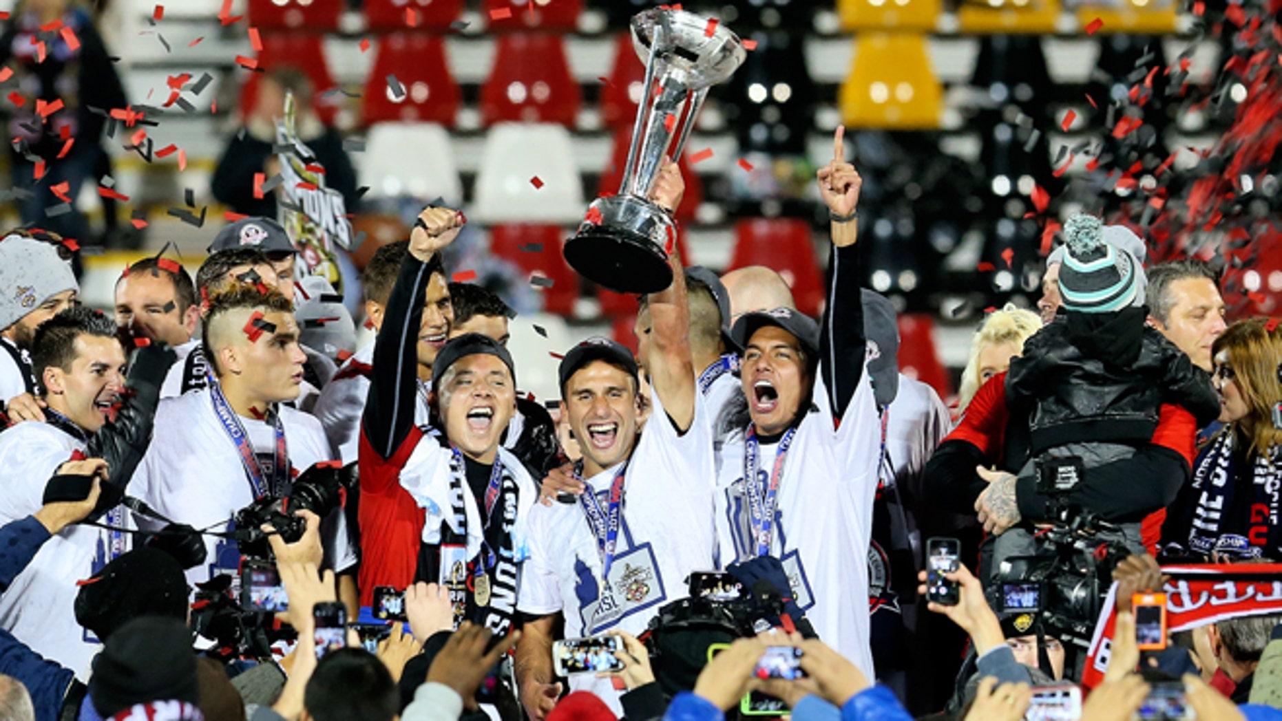 San Antonio Scorpions celebrate their 2014 NASL championship. (Photo: Courtesy NASL)