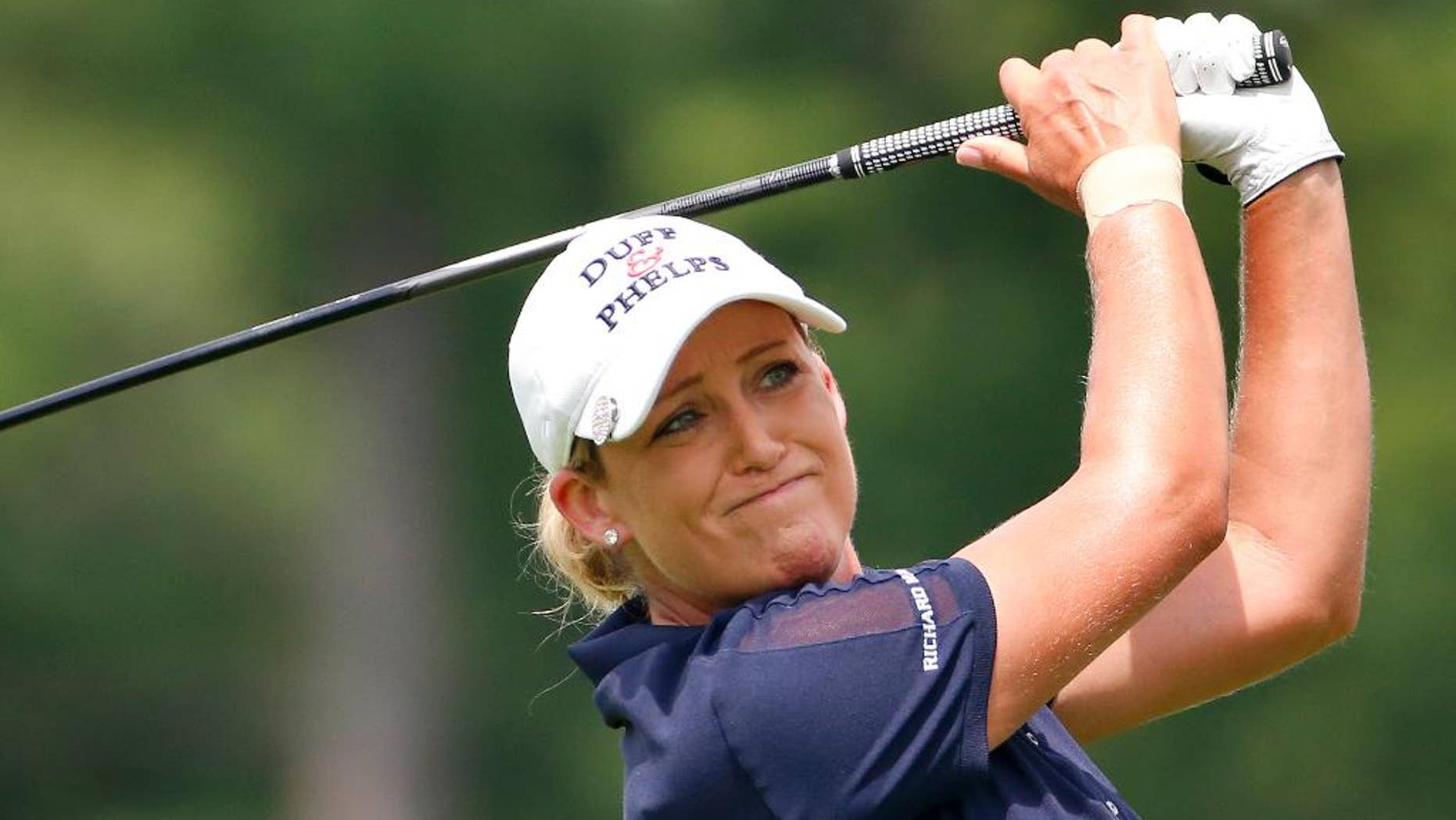 FILE - In this Thursday, July 9, 2015 file photo, Cristie Kerr tees off the 14th hole during the first round of the U.S. Women's Open golf tournament at Lancaster Country Club in Lancaster, Pa. Kerr was a supporter of President-elect Donald Trump in this election cycle, and even considers her occasional golfing buddy a friend, Tuesday, Nov. 15, 2016. (AP Photo/Gene J. Puskar, File)