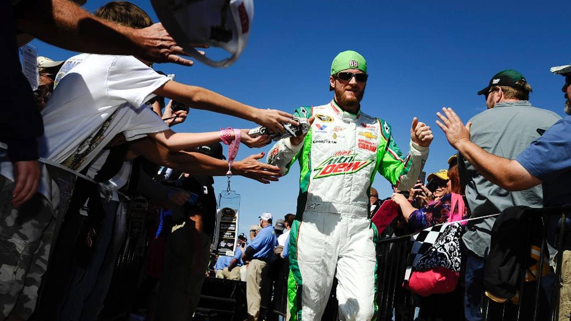 Brad Keselowski prepares for the start of the NASCAR Sprint Cup Series auto race at Talladega Superspeedway, Sunday, Oct. 19, 2014, in Talladega, Ala. (AP Photo/Rainier Ehrhardt)