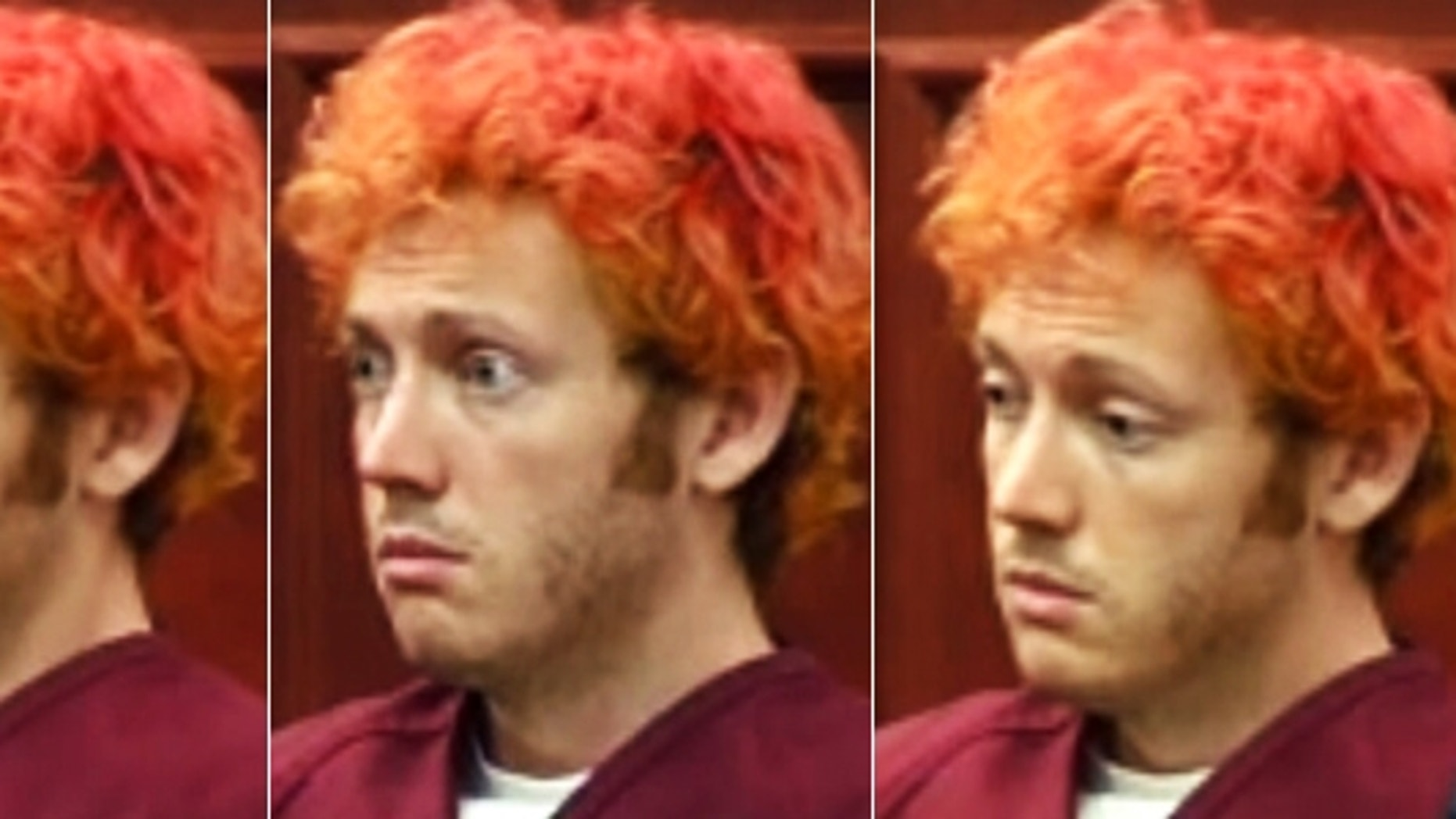 James Holmes sat subdued in court at his first appearance, declining to speak and looking dazed and confused. The appearance was short, and Holmes was silent as he was formally read his rights.