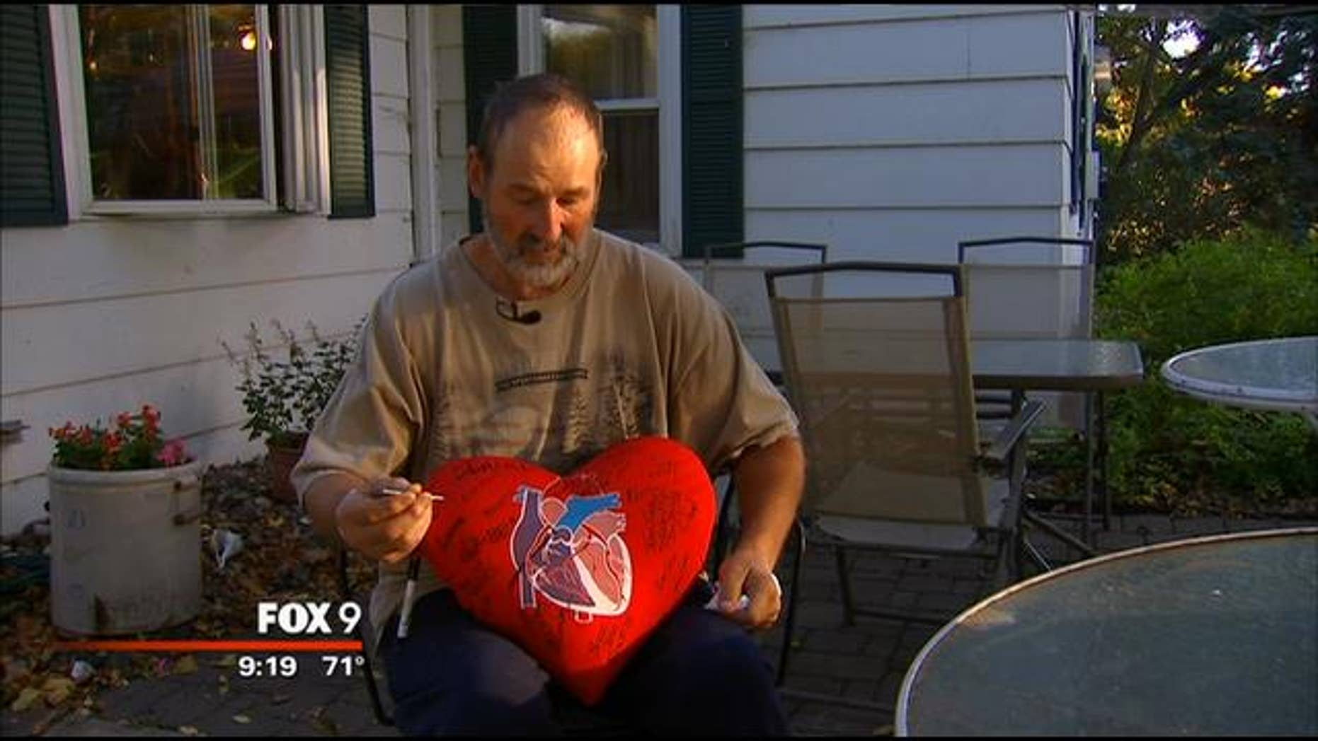 Euguene Rakow indicates precisely where he shot himself in the heart with a nail gun last week at his home in Minnesota. (MyFoxTwinCities.com)