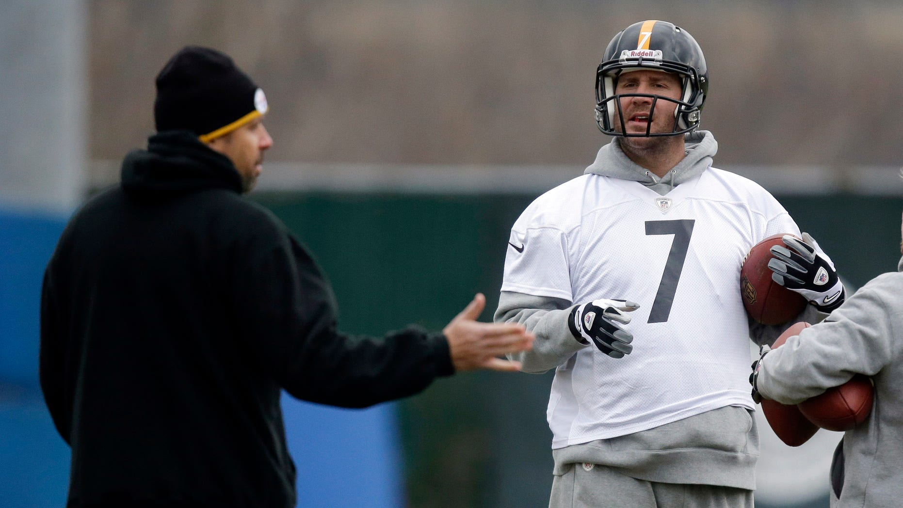 Pittsburgh Steelers quarterback Benn Roethlisberger (7) listens to offensive coordinator Todd Haley, left, during NFL football practice in Pittsburgh, Wednesday, Dec. 19, 2012. (AP Photo/Gene J. Puskar)