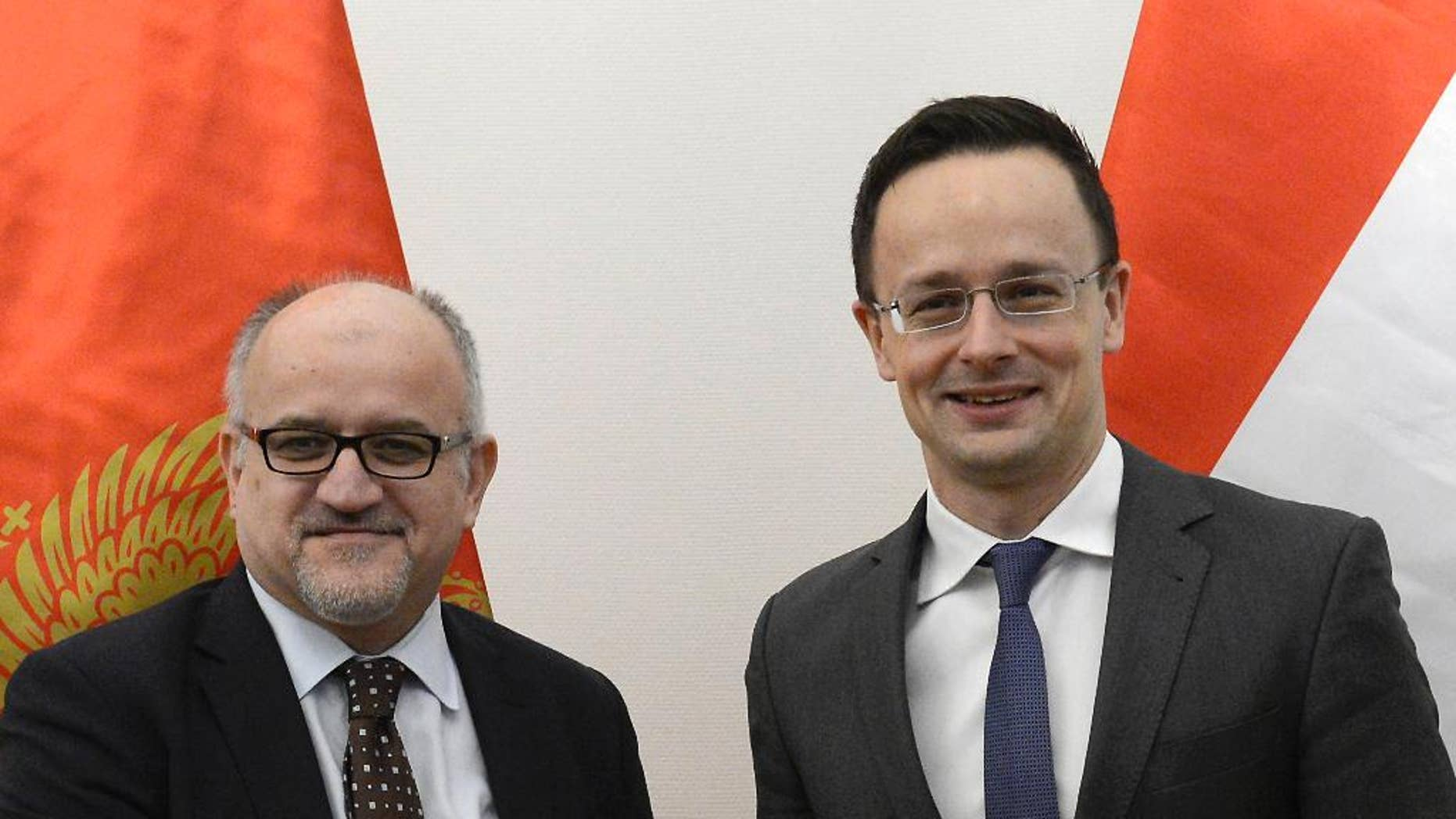 Montenegrin Foreign Minister Srdjan Darmanovic, left, and Hungarian Minister of Foreign Affairs and Trade Peter Szijjarto shake hands during their meeting in the Ministry of Foreign Affairs and Trade in Budapest, Hungary, Friday, Jan. 27, 2017. (Lajos Soos/MTI via AP)