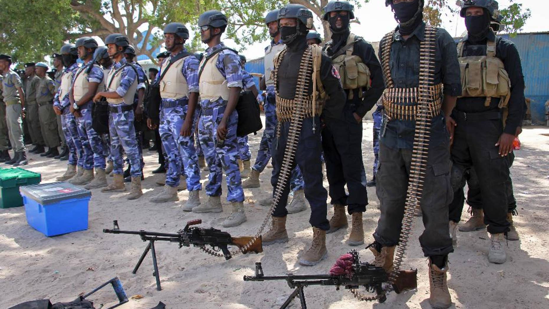 Somali soldiers prepare to secure the capital on the eve of presidential elections, at a police academy in Mogadishu.