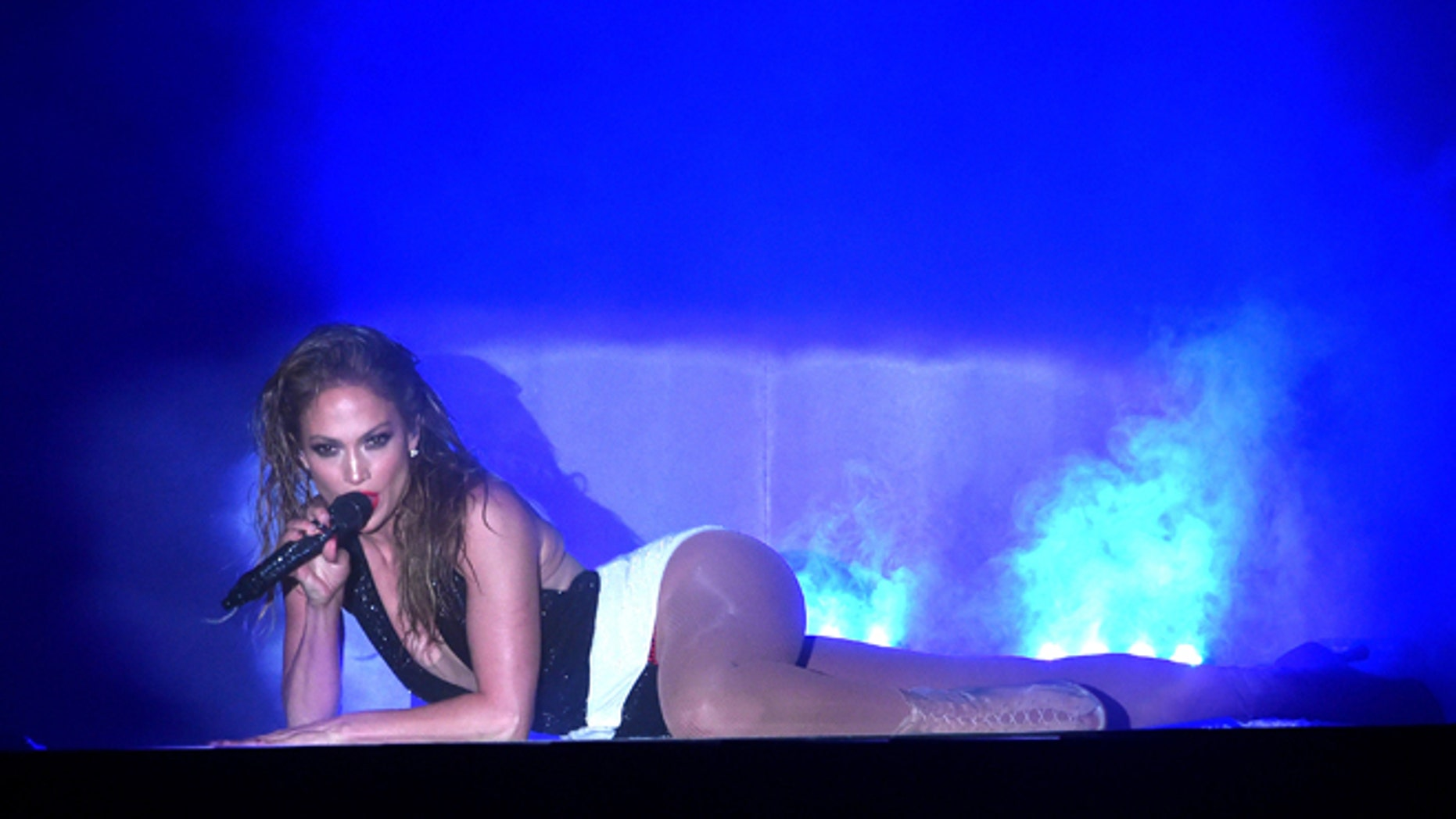 LOS ANGELES, CA - NOVEMBER 23:  Recording artist Jennifer Lopez performs onstage at the 2014 American Music Awards at Nokia Theatre L.A. Live on November 23, 2014 in Los Angeles, California.  (Photo by Kevin Winter/Getty Images)