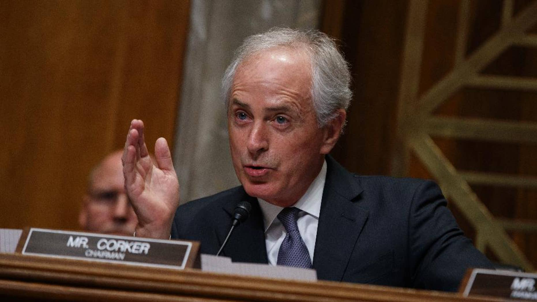 """FILE - In this Wednesday, Jan. 18, 2017, file photo, Sen. Bob Corker, R-Tenn., the chairman of the Foreign Relations Committee, speaks on Capitol Hill in Washington during the committee's confirmation hearing for UN Ambassador-designate, South Carolina Gov. Nikki Haley. When President Donald Trump paused the nation's refugee program with the stroke of a pen, top congressional leaders of his own party were left to find out the same way the general public did: from the media as Trump signed the order. Corker told reporters Monday, Jan. 30: """"I guess one of you guys probably told me about it. Thank you for that."""" Lawmakers complained that they were left in the dark as details of the plan were worked out. (AP Photo/Evan Vucci, File)"""