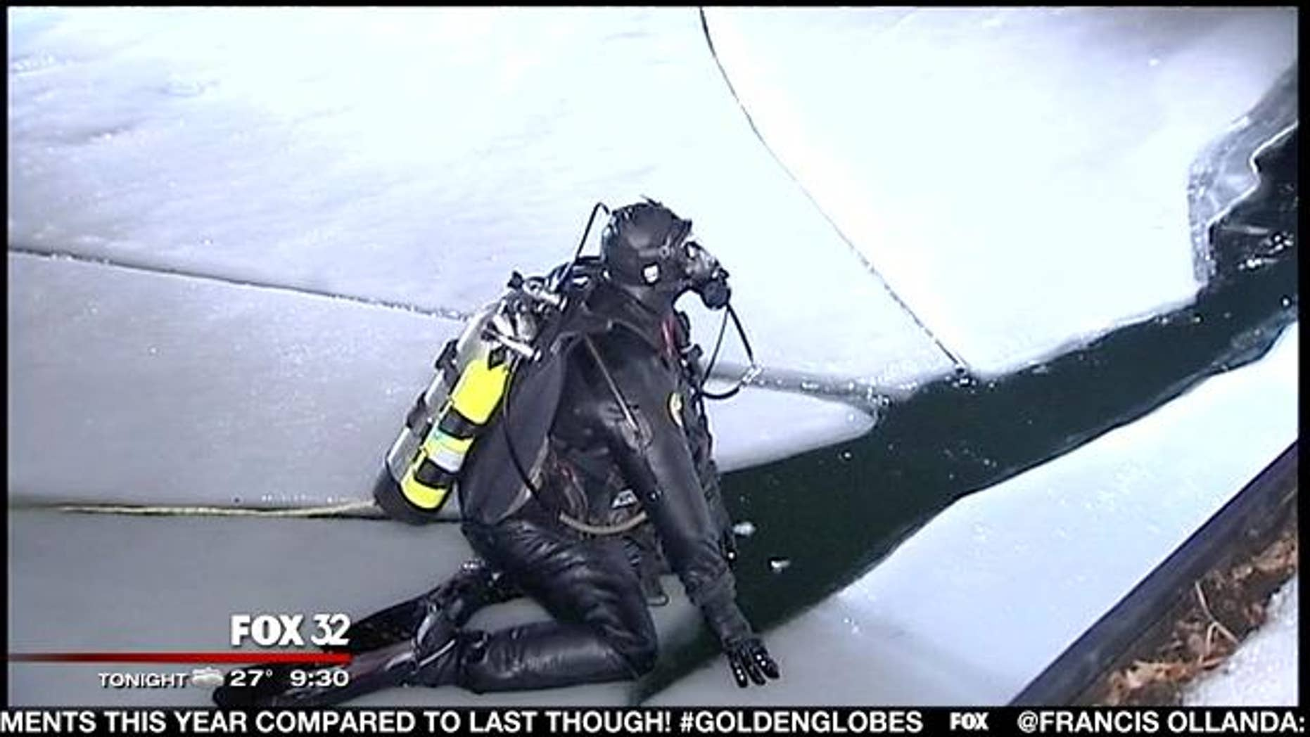 January 13, 2014: A diver prepares to search the Chicago River for a missing woman who fell in to the river while trying to help a friend early Monday. (MyFoxChicago.com)