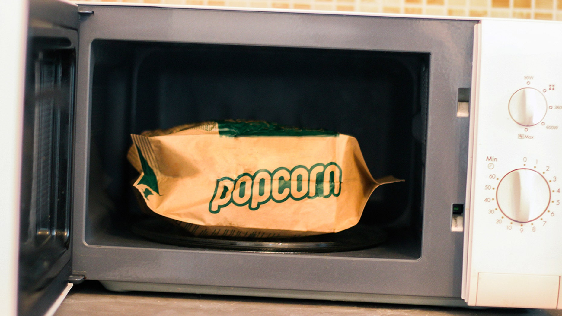 "Good news! Popcorn won't actually explode if you don't microwave it ""this side up."""
