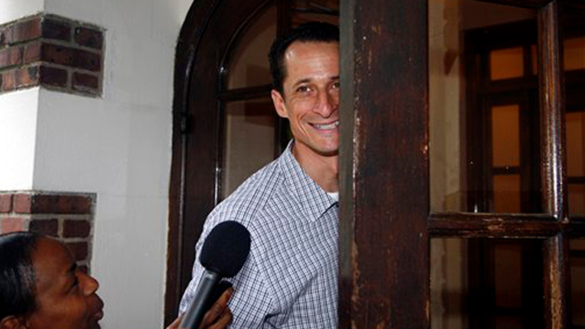 Rep. Anthony Weiner enters his home in New York June 11.