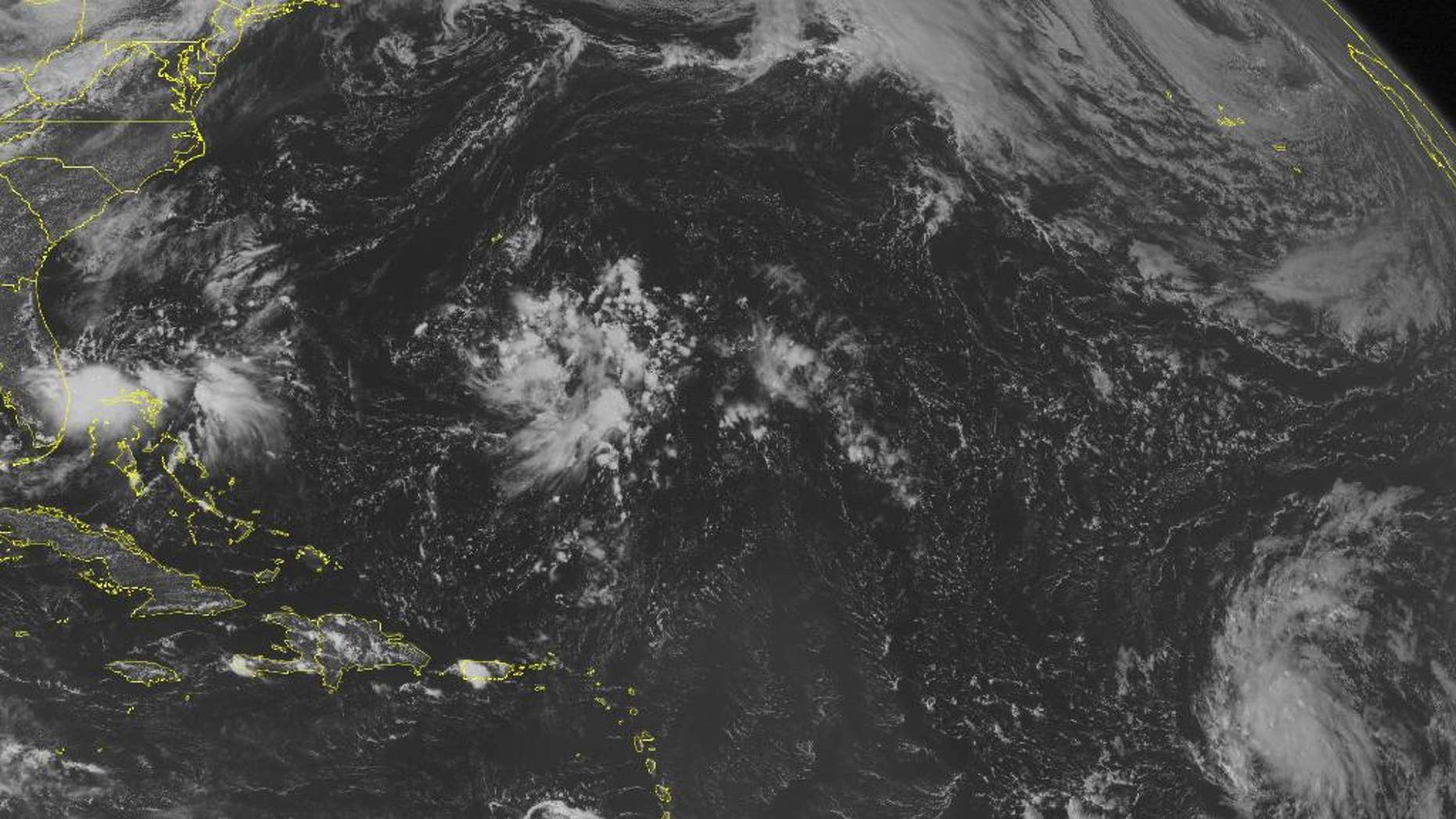 This NOAA satellite image taken Thursday, Sept. 11, 2014 at 01:45 PM EDT shows a tropical disturbance over the Bahamas bringing widespread rain and thunderstorms. This area may develop into a tropical depression in the coming days. Tropical Depression 6 in the central Atlantic will move westward and strengthen.(AP Photo/Weather Underground)