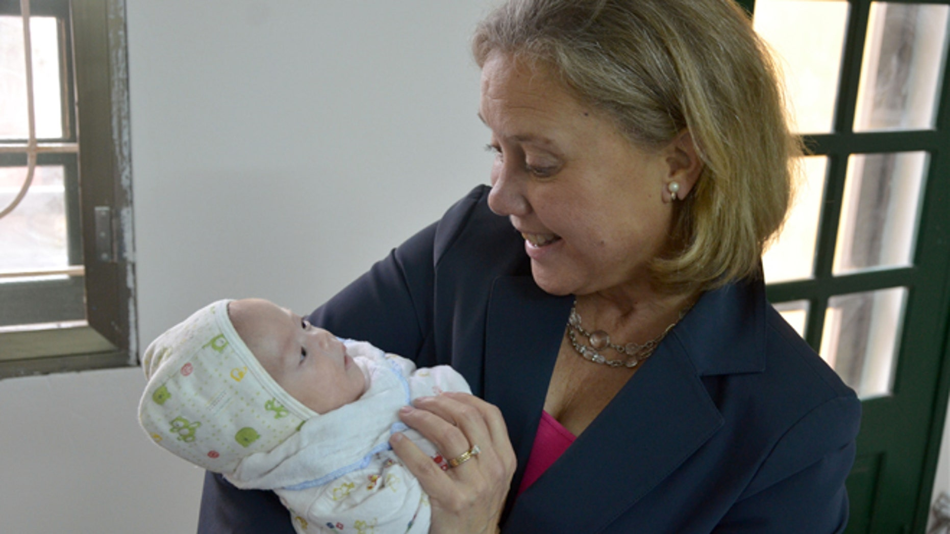 Feb. 20, 2013: Sen. Mary Landrieu, D-La., holds an infant during a visit to the Phu My Village orphanage in Vietnam.