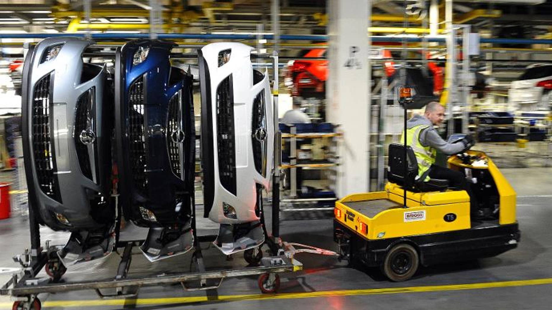 Vehicle parts for Vauxhall and Opel Astra cars are transported on the production line at the Vauxhall car factory in Ellesmere Port, northwest England, on May 17, 2012.