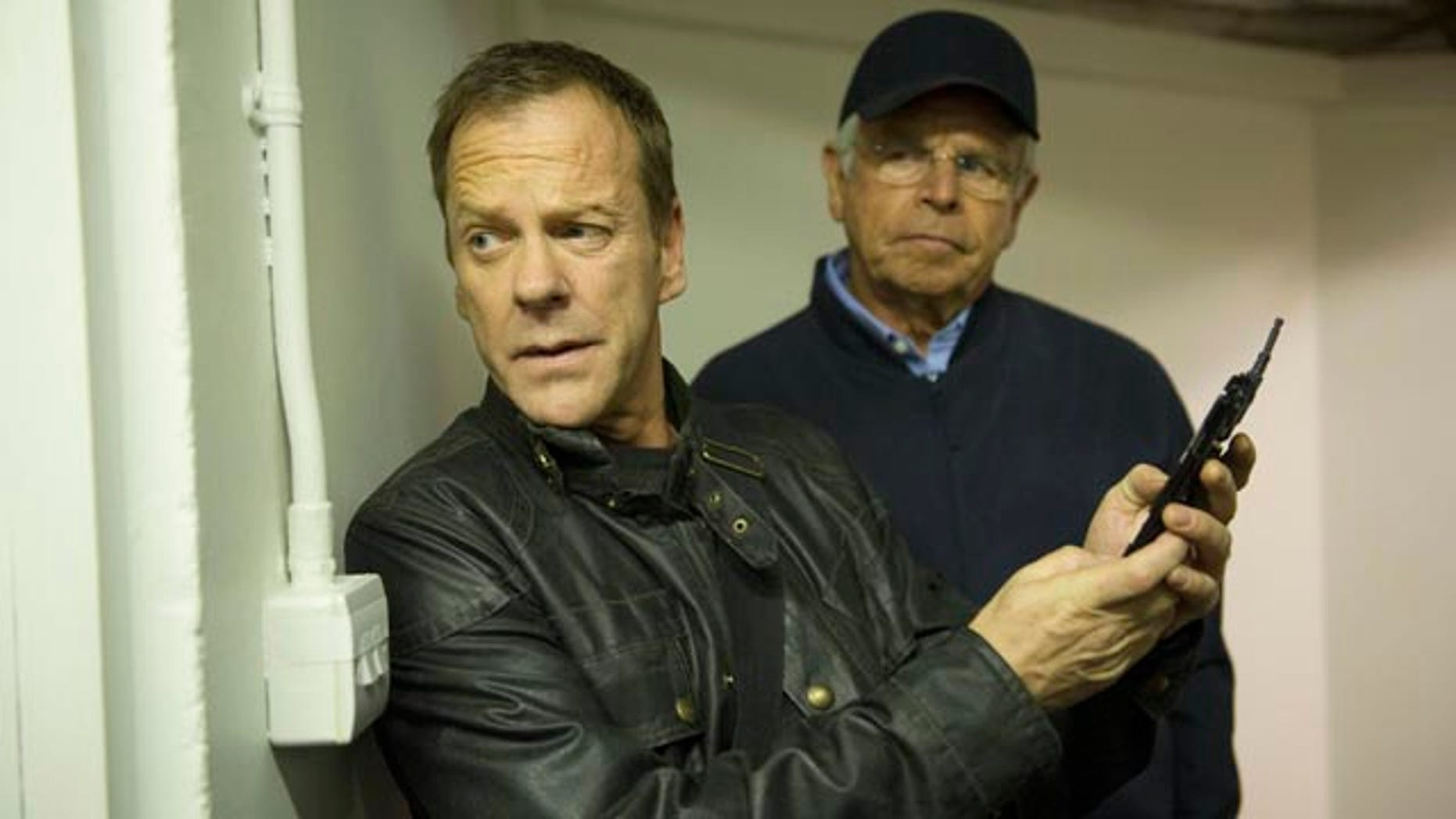 Jack Bauer (Kiefer Sutherland, left) moves President Heller (William Devane) from the Presidential residence in '24: LIVE ANOTHER DAY' (Daniel Smith/FOX)