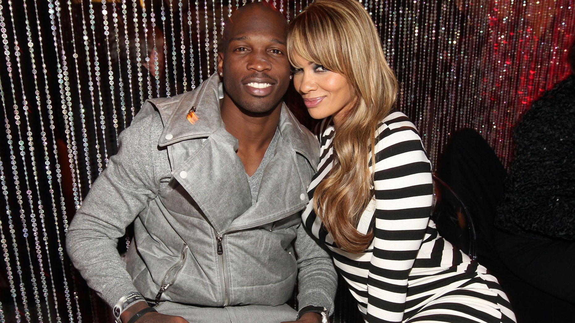 DALLAS, TX - FEBRUARY 04:  NFL player Chad Johnson of the Cincinnati Bengals and Evelyn Lozada attend the PepsiCo Super Bowl Weekend Kickoff Party featuring Lenny Kravitz and DJ Pauly D at Wyly Theater on February 4, 2011 in Dallas, Texas.  (Photo by Christopher Polk/Getty Images for PepsiCo)