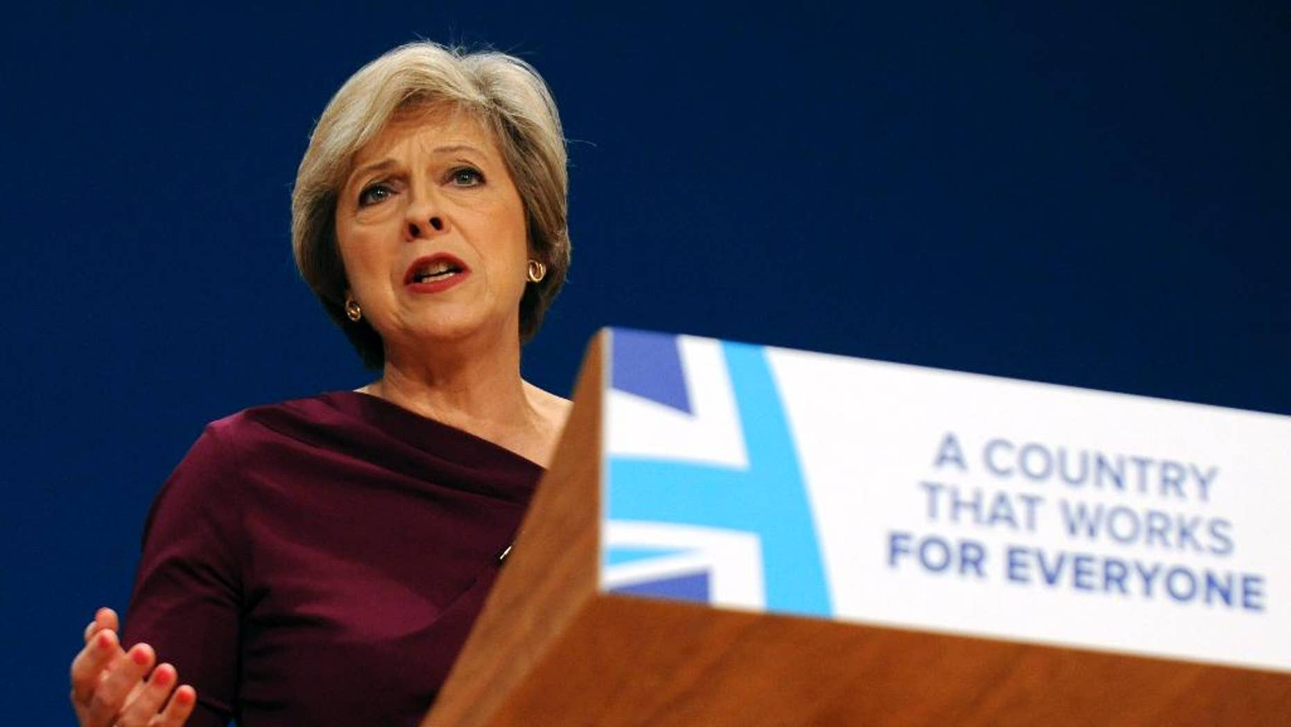 FILE - In this Wednesday, Oct. 5, 2016 file photo, Conservative Party Leader and Prime Minister Theresa May addresses delegates at the Conservative Party Conference at the ICC, in Birmingham, England. The pound has dropped more than 5 percent against the dollar since Oct. 2, when Prime Minister Theresa May announced plans to start formal talks on exiting the European Union by the end of March.  (AP Photo/Rui Vieira, file)