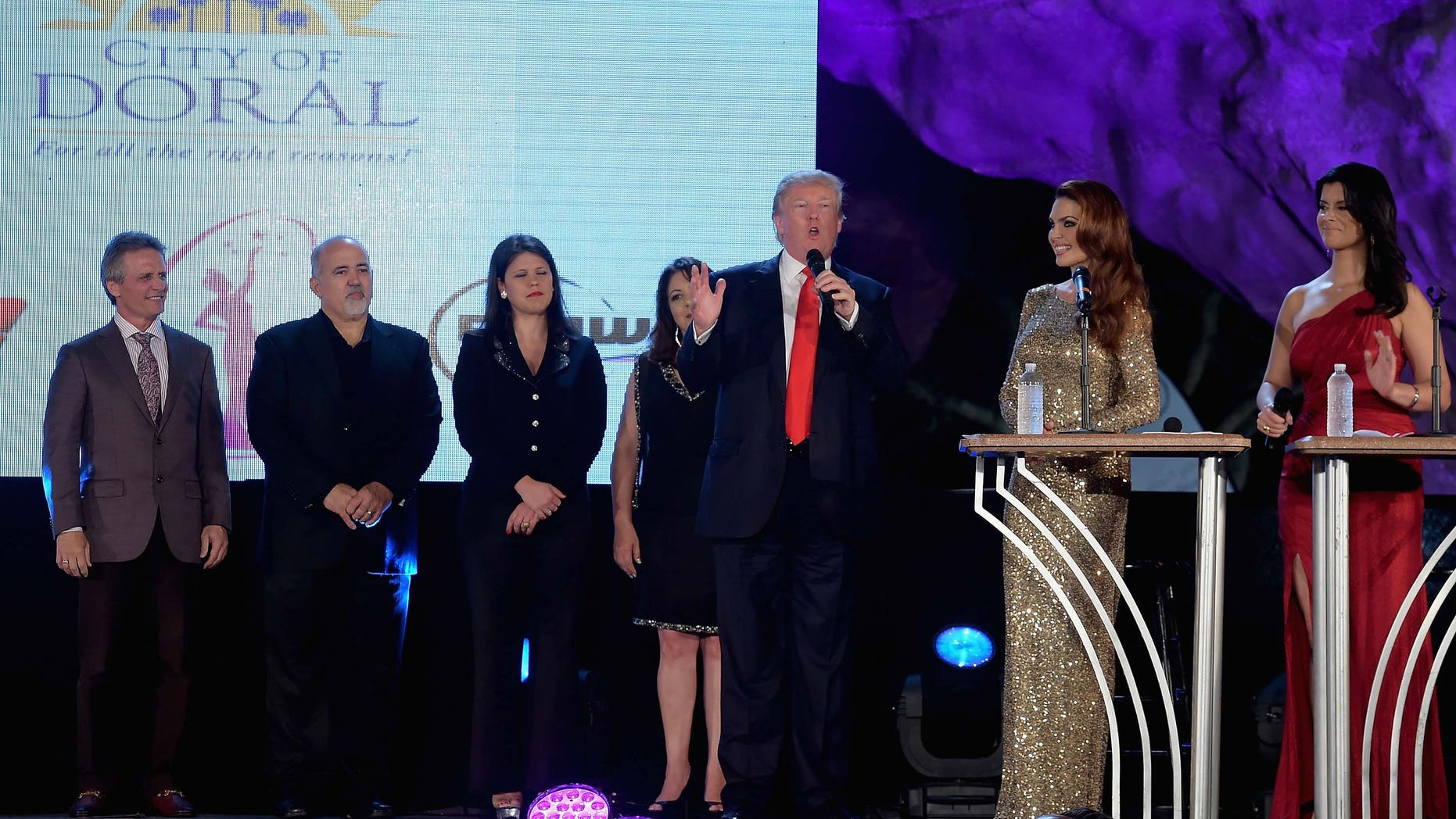 DORAL, FL - JANUARY 09:  Donald Trump,Barbara Palacios and Roxanne Vargas attends Miss Universe Welcome Event and Reception at Downtown Doral Park on January 9, 2015 in Doral, Florida.  (Photo by Gustavo Caballero/Getty Images)