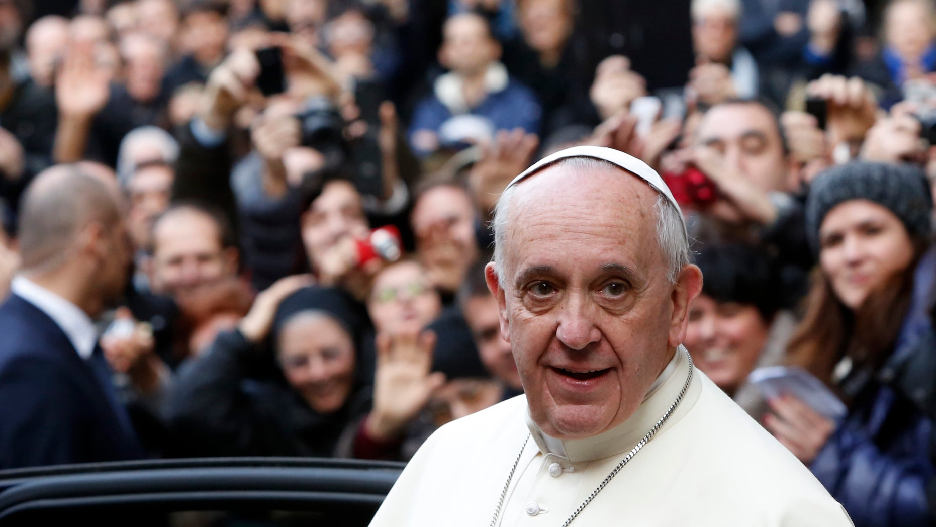 Pope Francis leaves Rome's Jesus' Church after celebrating a mass with the Jesuits, on the occasion of the order's titular feast, Friday, Jan. 3, 2014. (AP Photo/Riccardo De Luca)