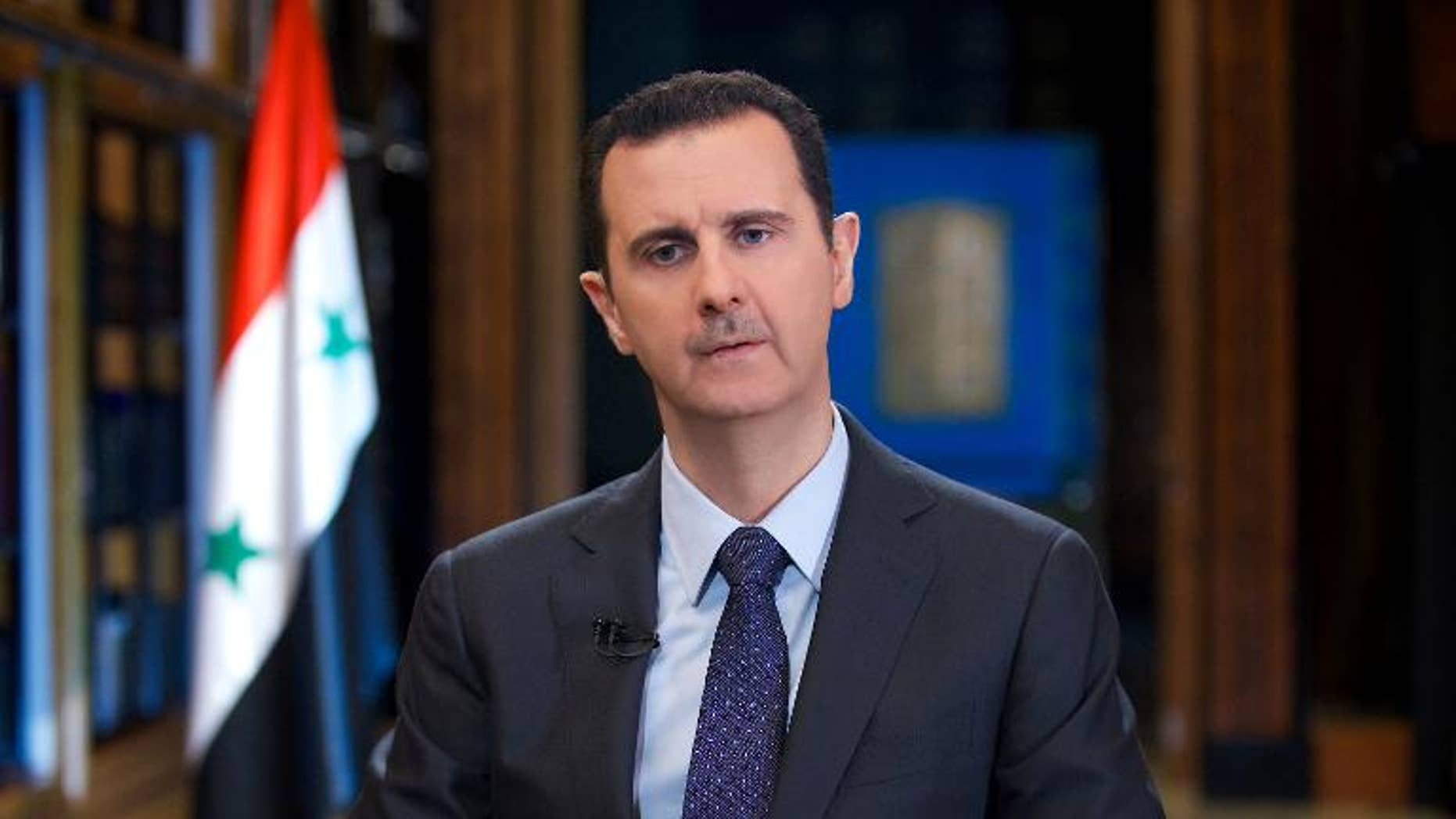 Syrian President Bashar al-Assad gives an interview with Venezuelan television station TeleSUR in Damascus, in a picture released by the official Syrian Arab News Agency on September 25, 2013