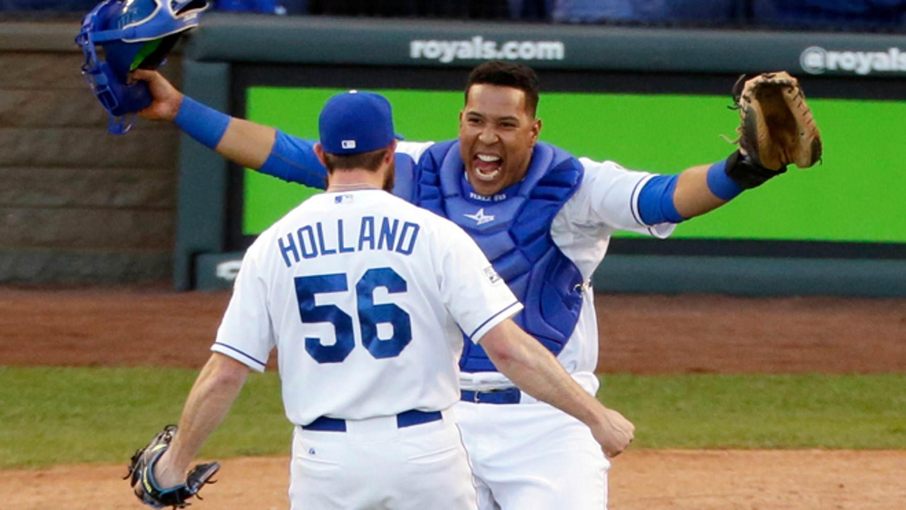 Kansas City Royals relief pitcher Greg Holland and catcher Salvador Perez celebrate after the Royals defeated the Baltimore Orioles 2-1 in Game 4 of the American League baseball championship series Wednesday, Oct. 15, 2014, in Kansas City, Mo. The Royals advance to the World Series. (AP Photo/Michael Conroy)