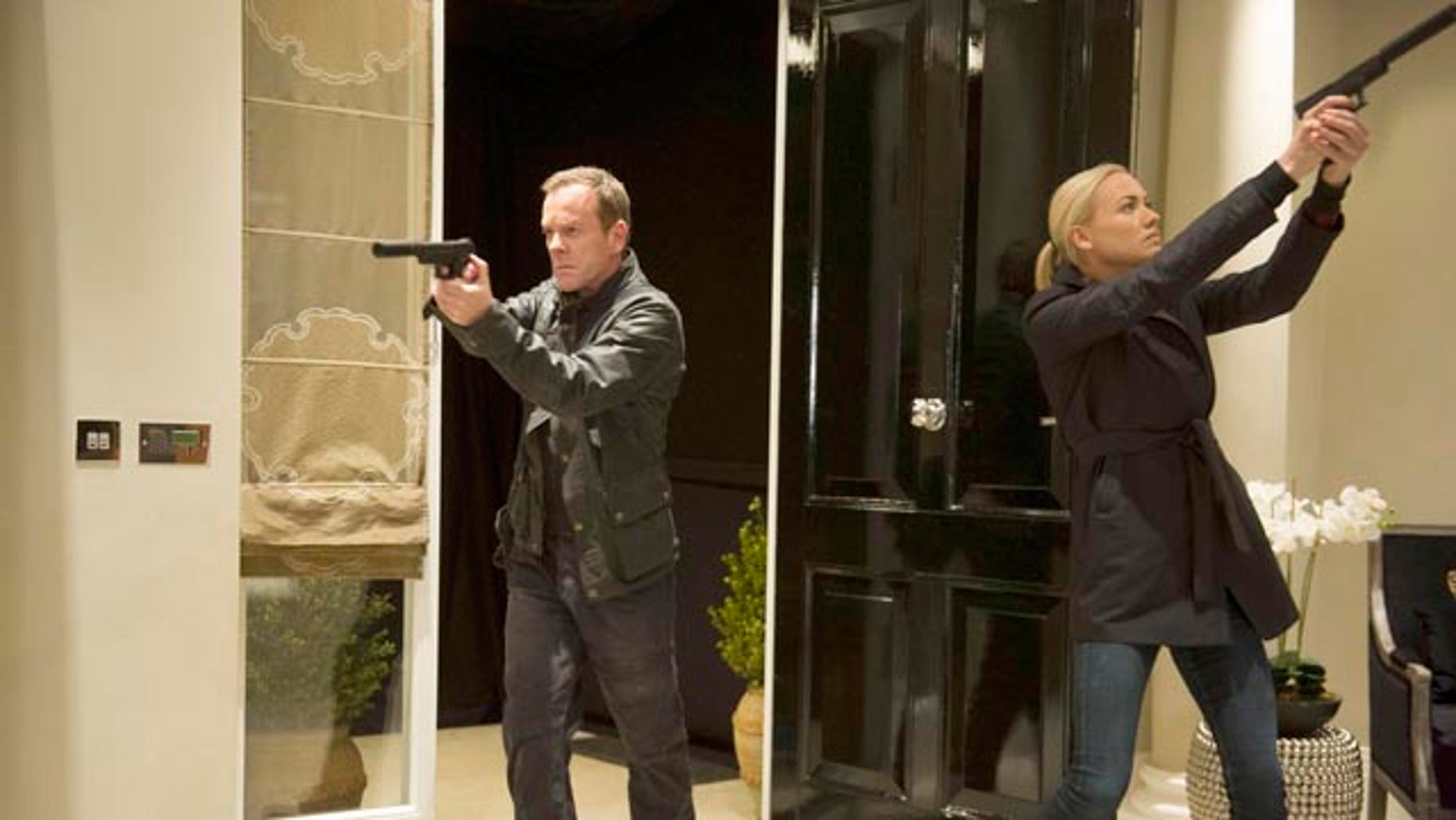 Kiefer Sutherland (Jack Bauer) and Yvonne Strahovski (Kate Morgan) take aim in '24: Live Another Day' (courtesy Fox Broadcasting)