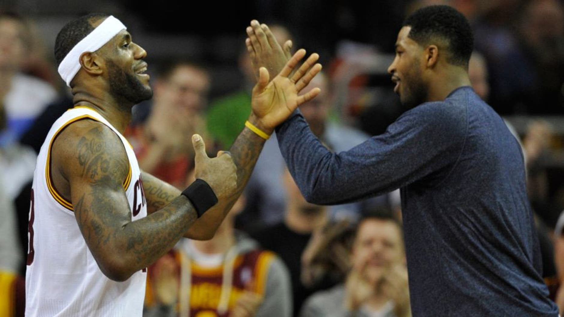 Feb 5, 2015; Cleveland, OH, USA; Cleveland Cavaliers forward LeBron James (left) celebrates with center Tristan Thompson (13) in the second quarter against the Los Angeles Clippers at Quicken Loans Arena. Mandatory Credit: David Richard-USA TODAY Sports