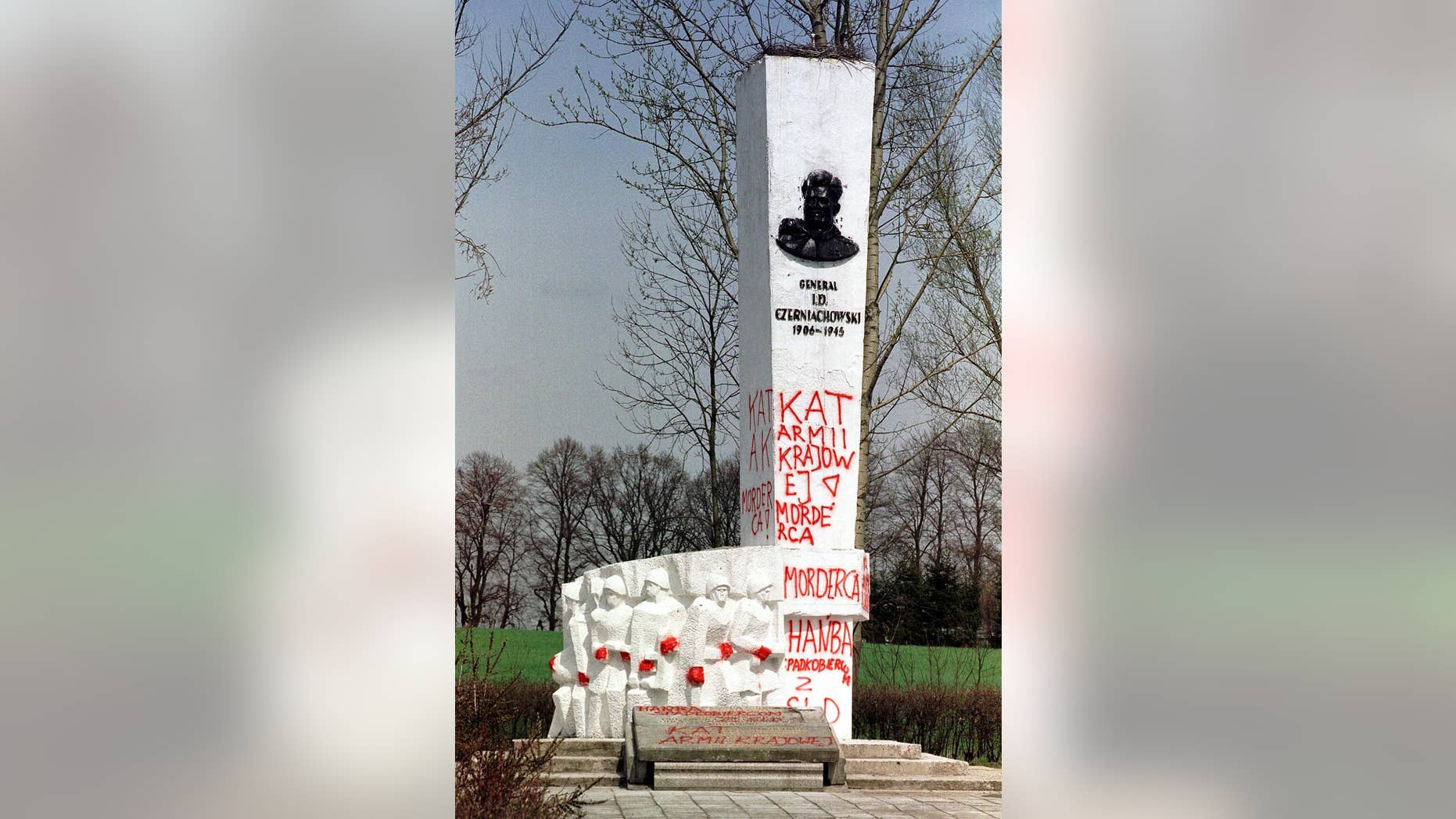 """FILE- In this April 30, 2001 file photo taken in Pieniezno, Poland, graffiti with insults like """"Murderer"""" and """"Shame"""" can be seen on a memorial to Soviet General Ivan Chernyakhovsky, who is considered a symbol of the imposition of communism in Poland, but a national hero in Russia. Russian Ambassador Sergey Andreev on Friday described the Soviet's 1939 invasion of Poland as an act of self-defense, not aggression. The comment prompted Poland's Foreign Ministry to declare Saturday, Sept. 26, 2015, that the ambassador """"undermines historical truth"""" and seems to be trying to justify Stalinist crimes. (AP Photo/Wojtek Jakubowski, file)  POLAND OUT"""