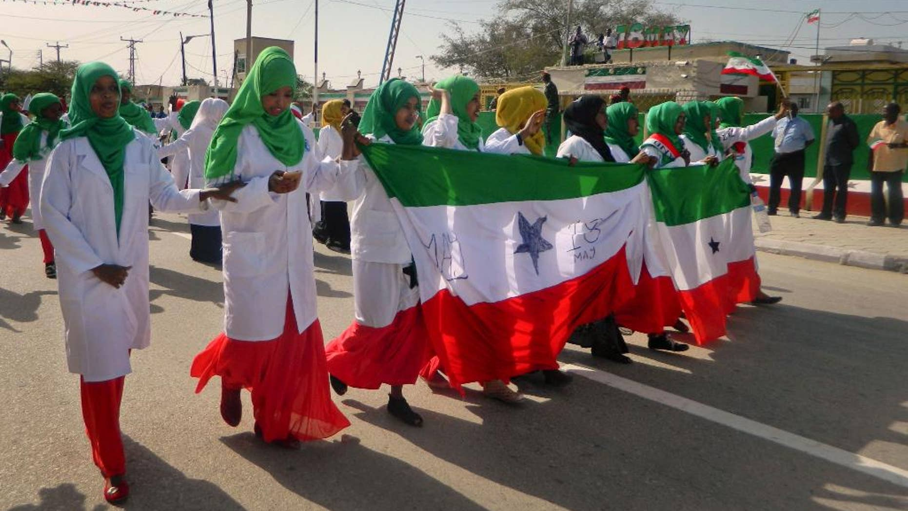 Women march in a procession to celebrate the 25th anniversary of proclaimed independence in the capital Hargeisa, Somaliland, a breakaway region of Somalia Wednesday, May 18, 2016. Somaliland is celebrating 25 years since the region proclaimed its independence and has experienced relative stability and economic prosperity over the years, even though Somalia has been wracked by deadly violence. (AP Photo/Barkhad Dahir).