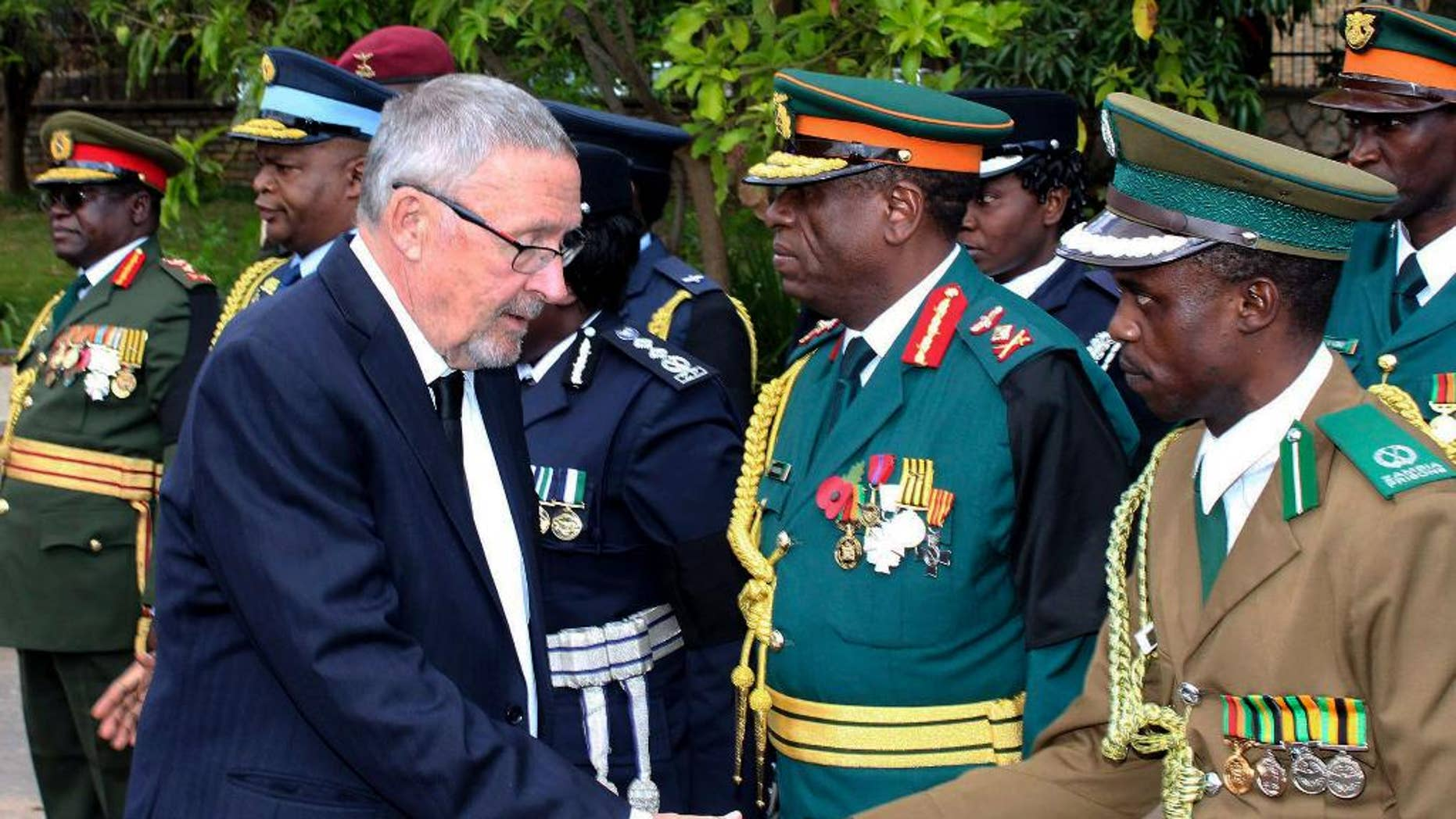 Zambia's vice president Guy Scott greets defense and security chiefs shortly after taking over as acting president, following the death in London on late Tuesday of President Michael Sata, Lusaka, Wednesday, Oct. 29, 2014. Scott, a white Zambian of Scottish descent, became the country's acting president on Wednesday, making him the first white leader of a sub-Saharan African nation since F.W. de Klerk, the apartheid-era head of South Africa who was voted out of power in 1994. (AP Photo)