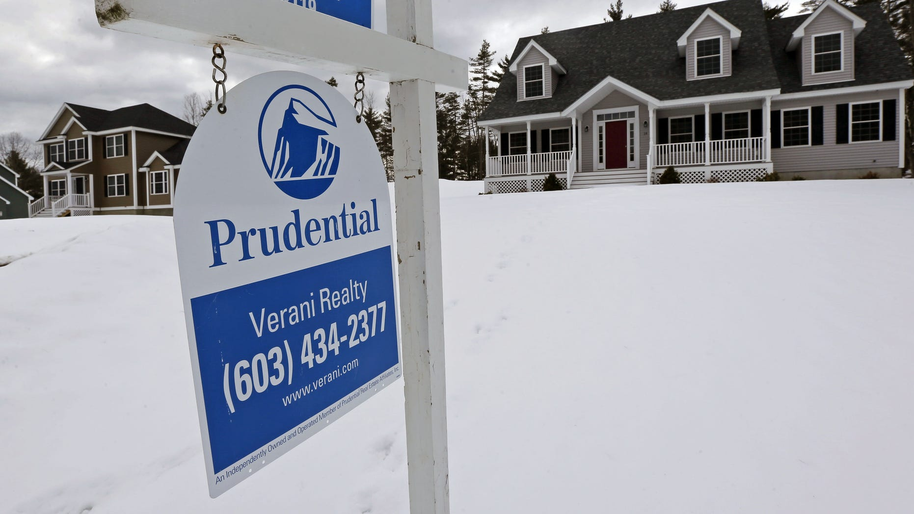 FILE - In this March 5, 2013 file photo, a home is for sale in Auburn, N.H.  Standard & Poor's/Case-Shiller reports on home prices in December on Tuesday, Feb. 25, 2014. (AP Photo/Charles Krupa, File)