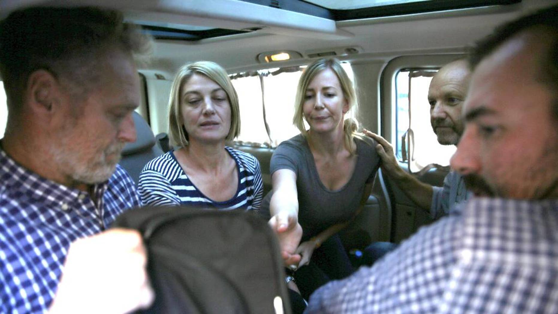Australian journalist Tara Brown, second left, and Sally Faulkner, center, with other members of the TV crew.