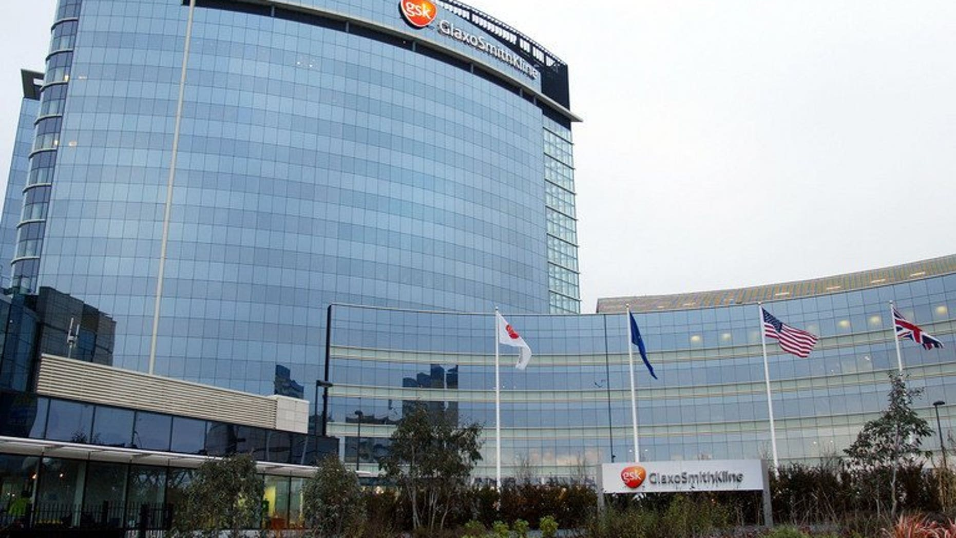 The headquarters of pharmaceutical company GlaxoSmithKline (GSK) in west London, pictured in 2002. Chinese police have detained four top executives of GSK in China for alleged bribery and other offences, according to state media.